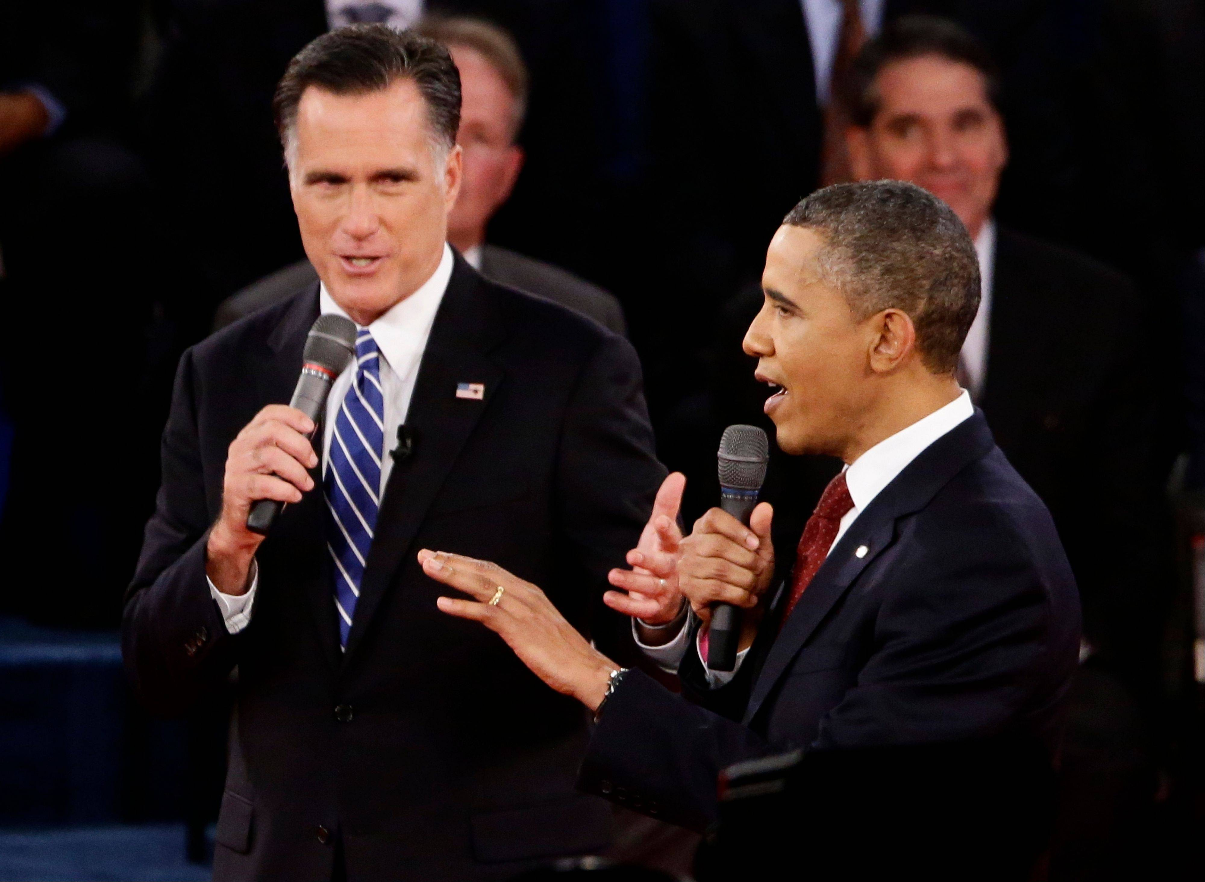 President Barack Obama and Republican presidential candidate and former Massachusetts Gov. Mitt Romney speak during the second presidential debate at Hofstra University in Hempstead, N.Y., Tuesday.