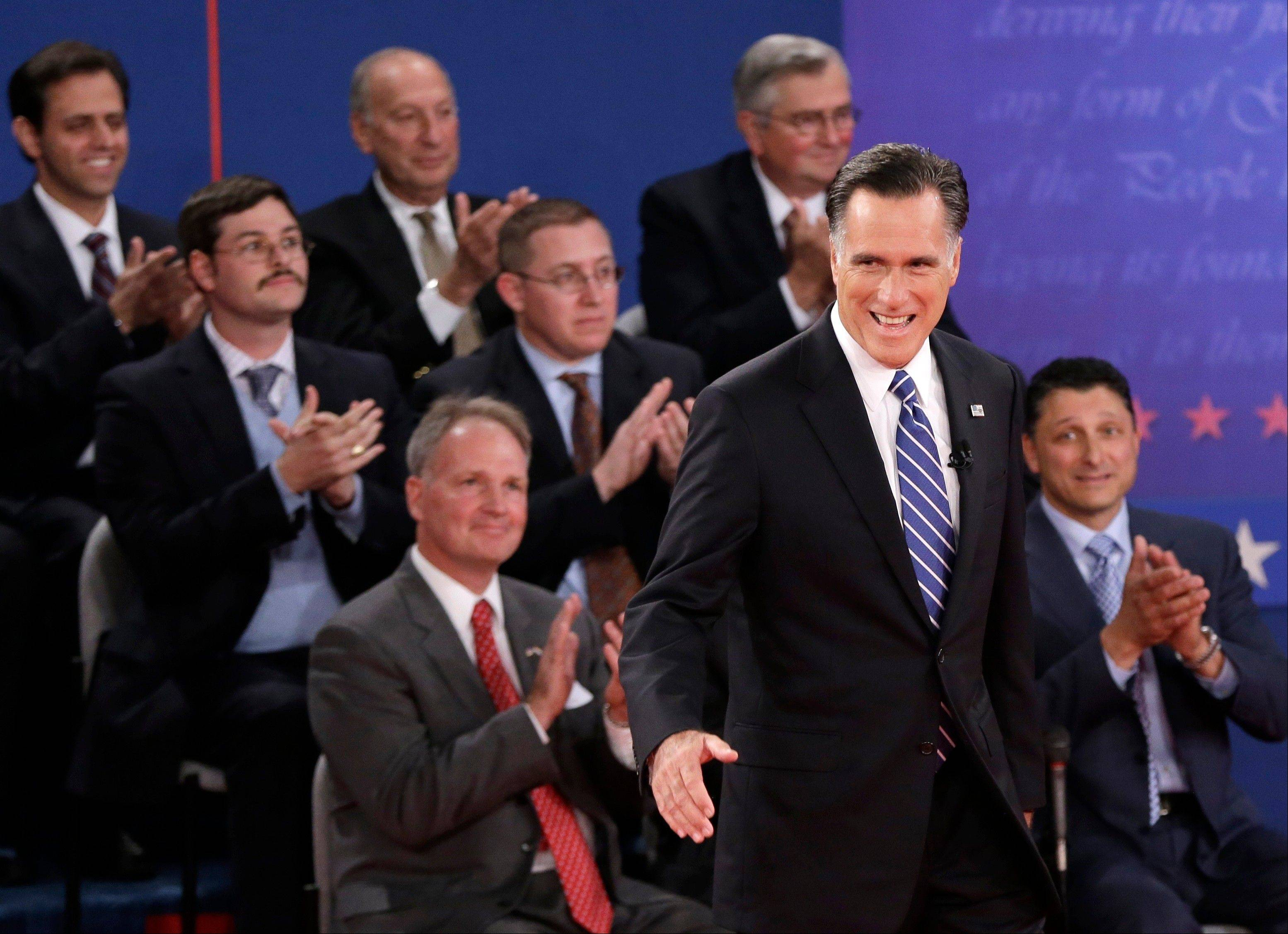 Members of the audience applaud as Republican presidential nominee Mitt Romney arrives for the second presidential debate at Hofstra University, Tuesday, Oct. 16, 2012, in Hempstead, N.Y.