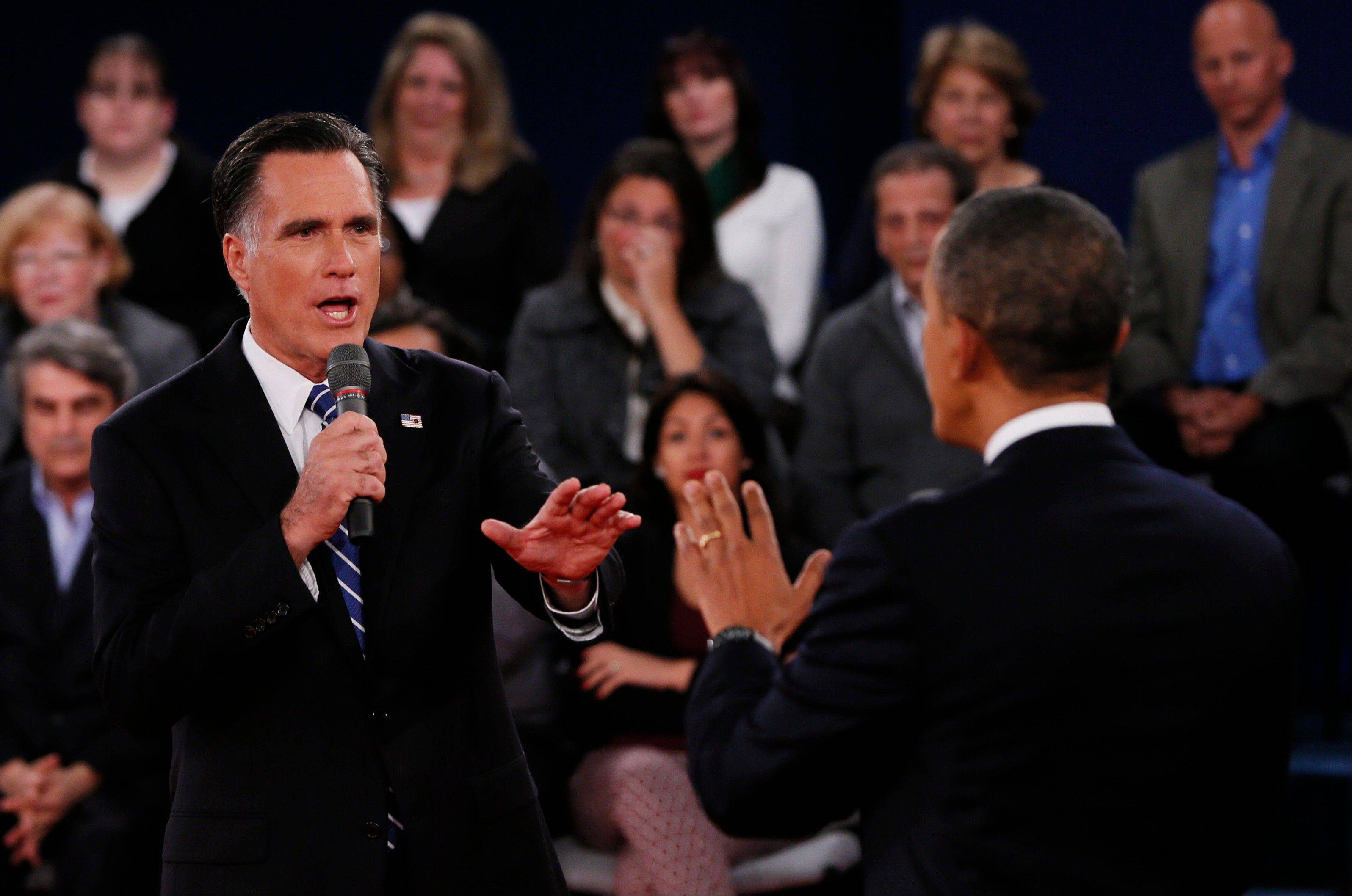 Republican presidential nominee Mitt Romney, left, addresses President Barack Obama during the second presidential debate at Hofstra University, Tuesday, Oct. 16, 2012, in Hempstead, N.Y.