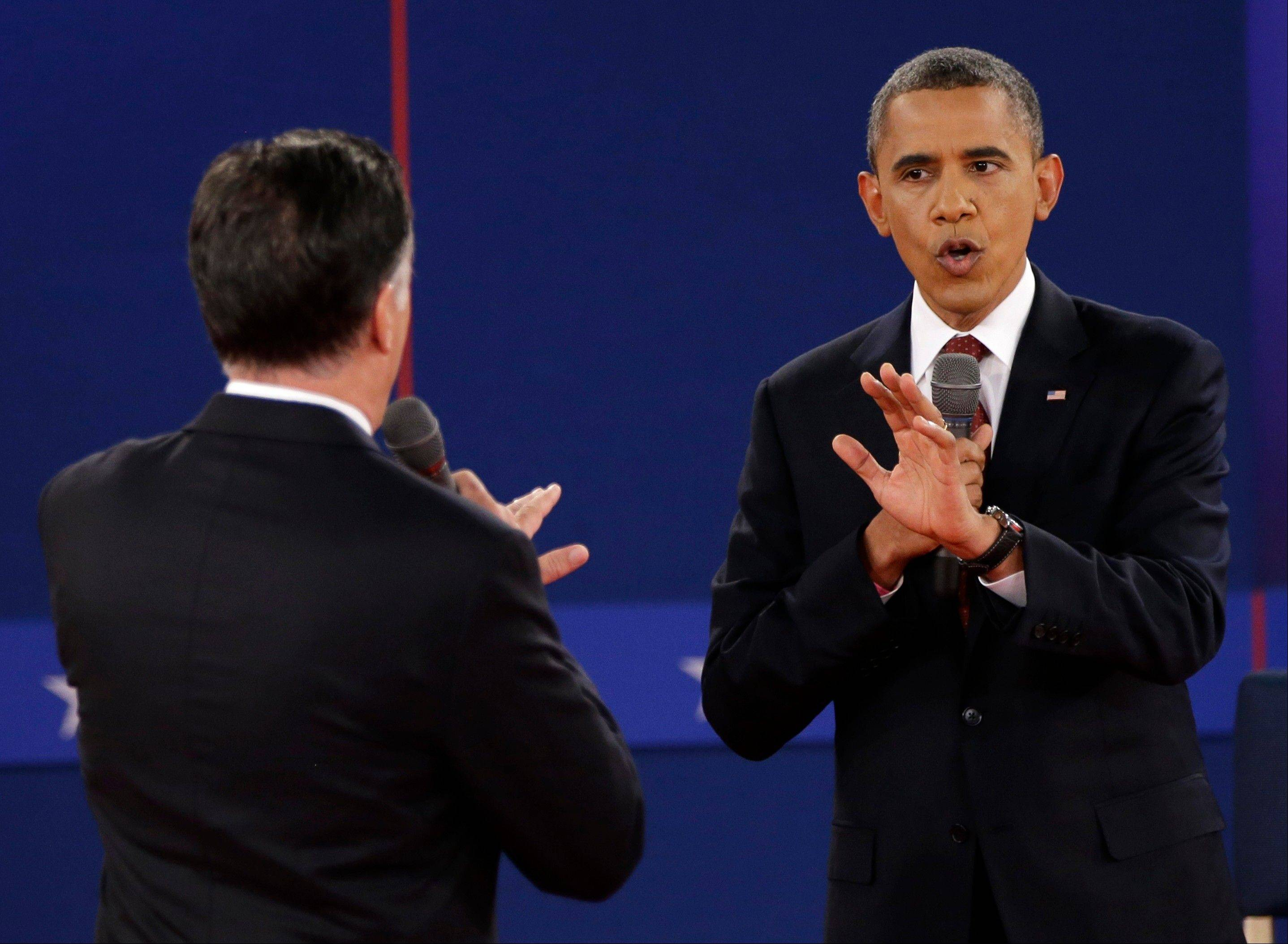 President Barack Obama and Republican presidential nominee Mitt Romney speak during the second presidential debate at Hofstra University, Tuesday, Oct. 16, 2012, in Hempstead, N.Y.