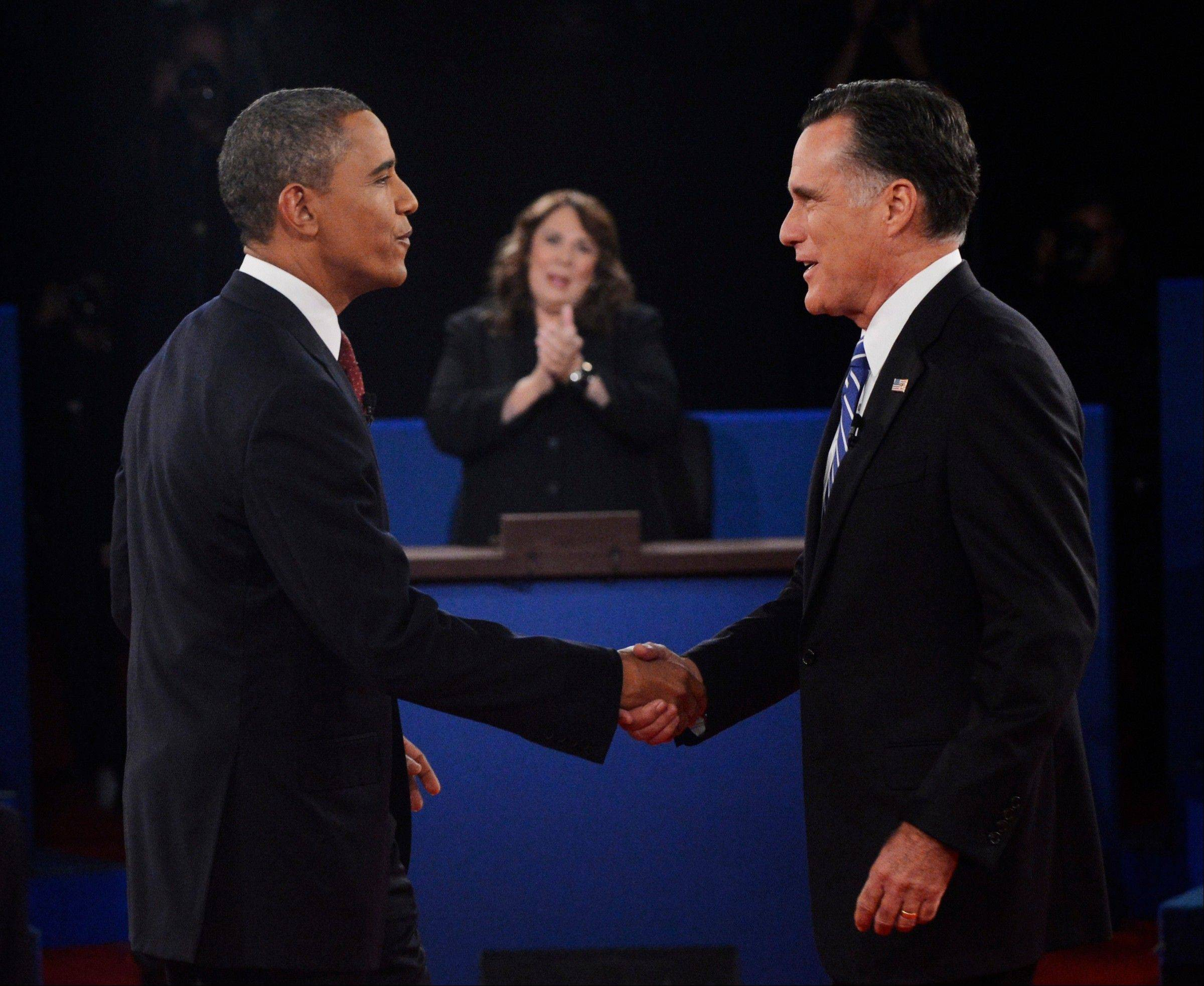 Moderator Candy Crowley, center, applauds as President Barack Obama, left, shakes hands with Republican presidential nominee Mitt Romney during the second presidential debate at Hofstra University, Tuesday, Oct. 16, 2012, in Hempstead, N.Y.