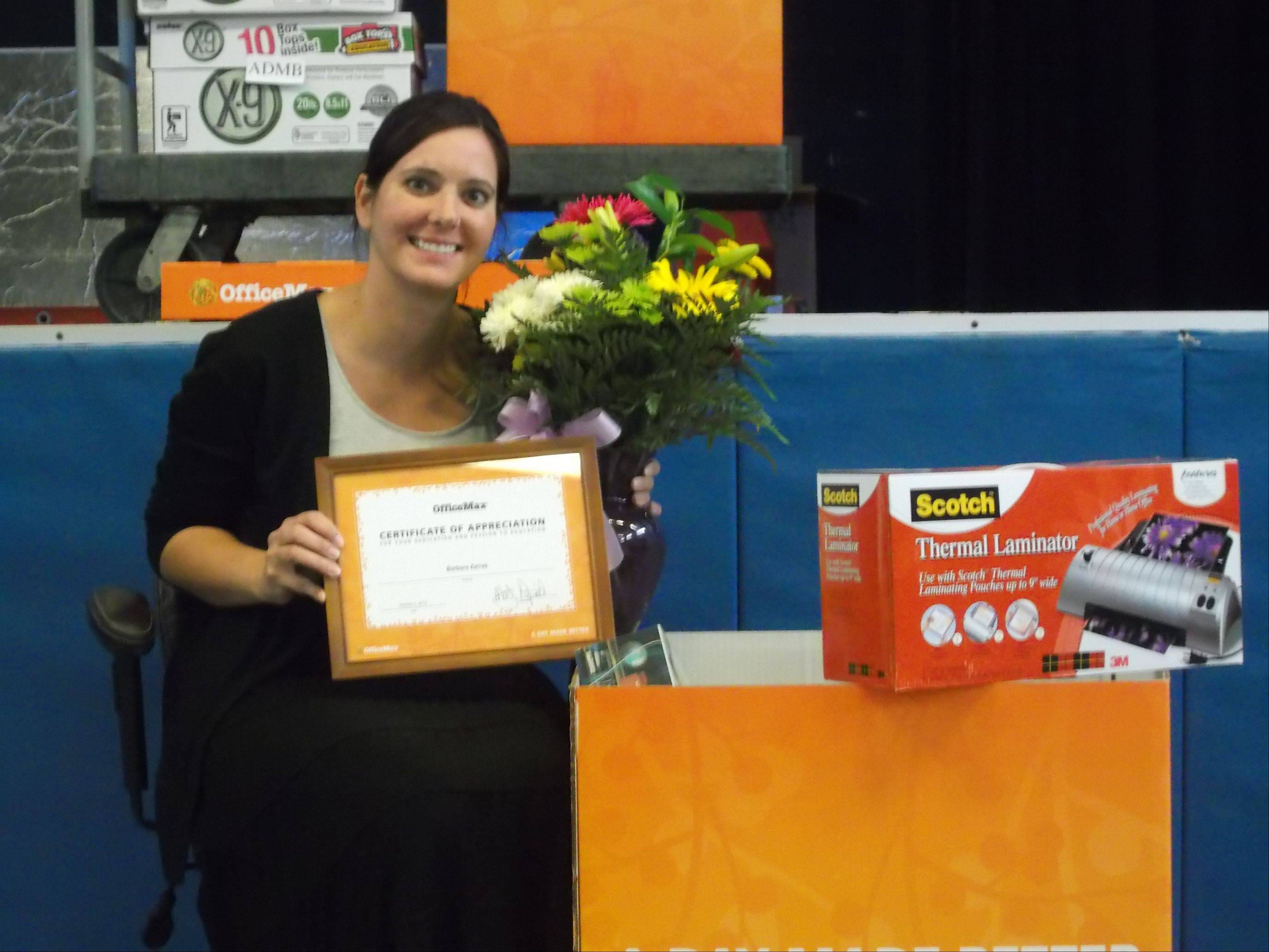 "Barbara Zarras, a teacher at Avon Center School in Grayslake, recently was honored with ""A Day Made Better"" award."