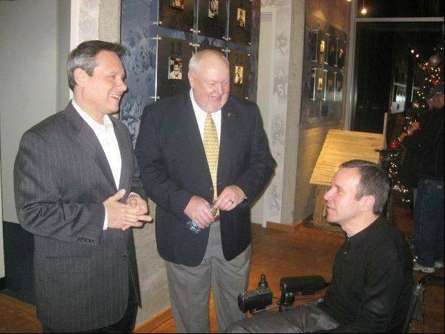 Shown here at a Chicago Bears fundraiser for the Gridiron Alliance in 2011, charity founder Don Grossnickle, center, chats with fellow board member Steve Herbst, right, of Palatine and Bears broadcaster Jeff Joniak, left. Grossnickle, 64, has spent 13 years as an unwavering advocate for young athletes with catastrophic injuries.
