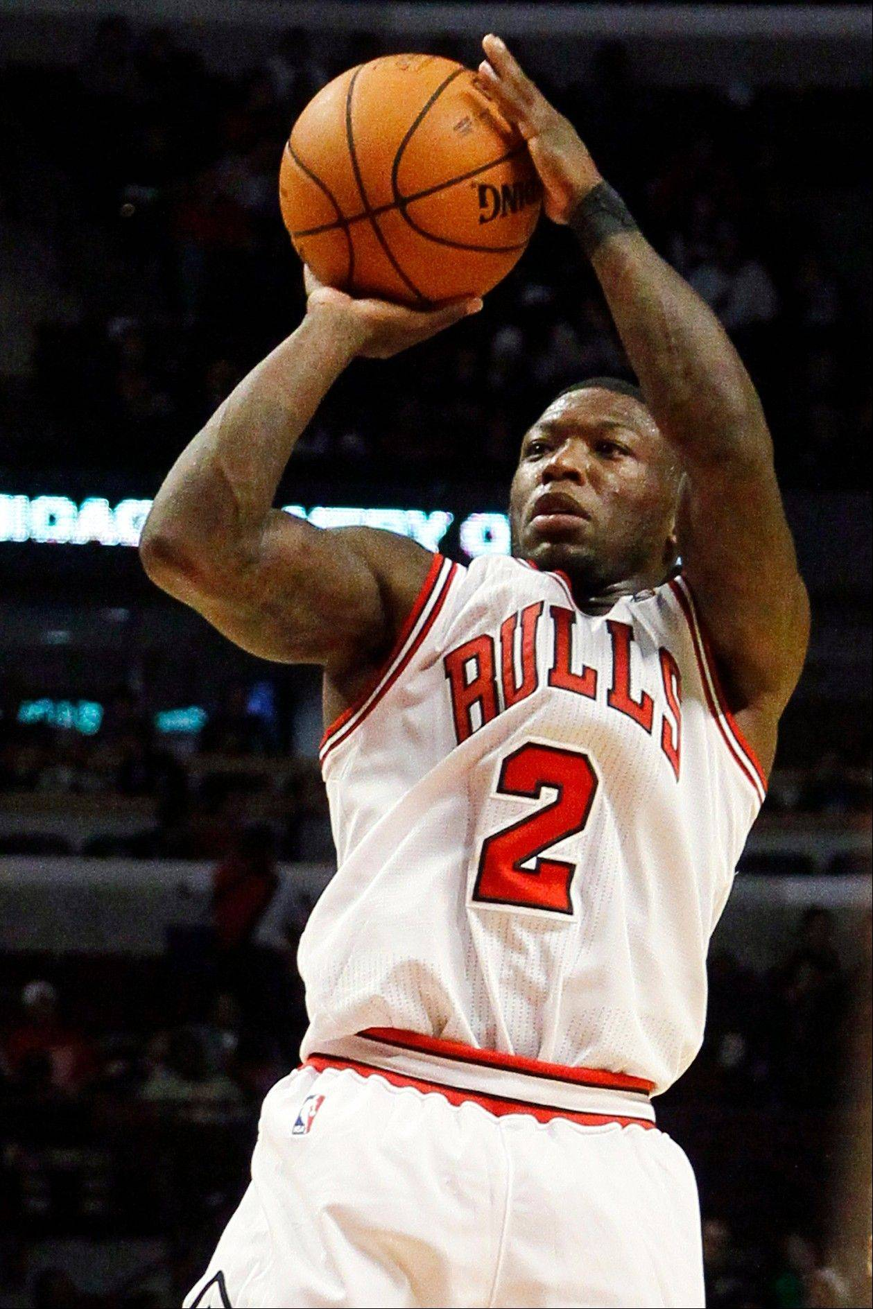 Bulls guard Nate Robinson finished with 24 points and 13 rebounds in Tuesday night's preseason victory over the Milwaukee Bucks.