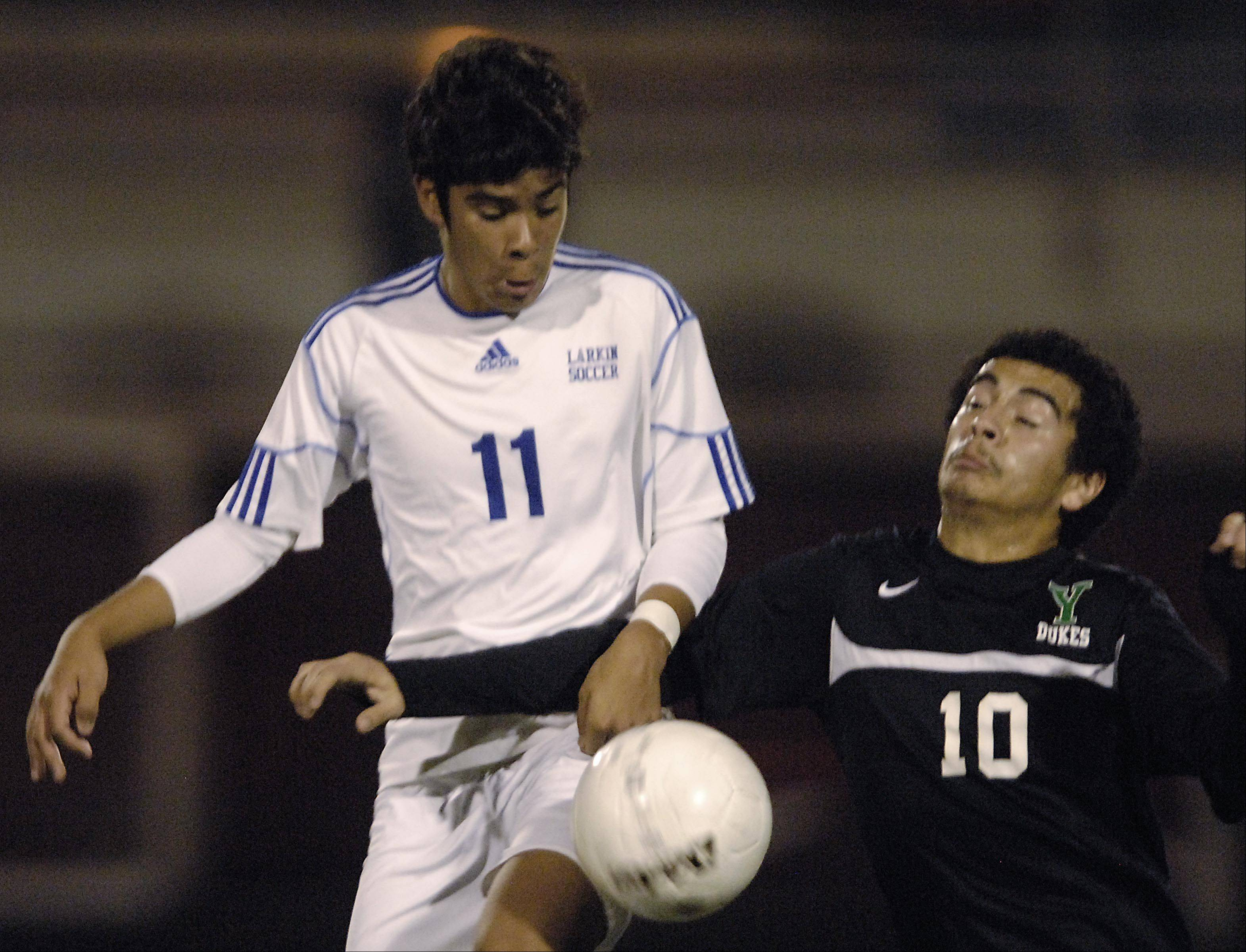 Larkin's Diego Ramirez and York's Victor Martinez, right, battle Tuesday in the Schaumburg regional playoff game.