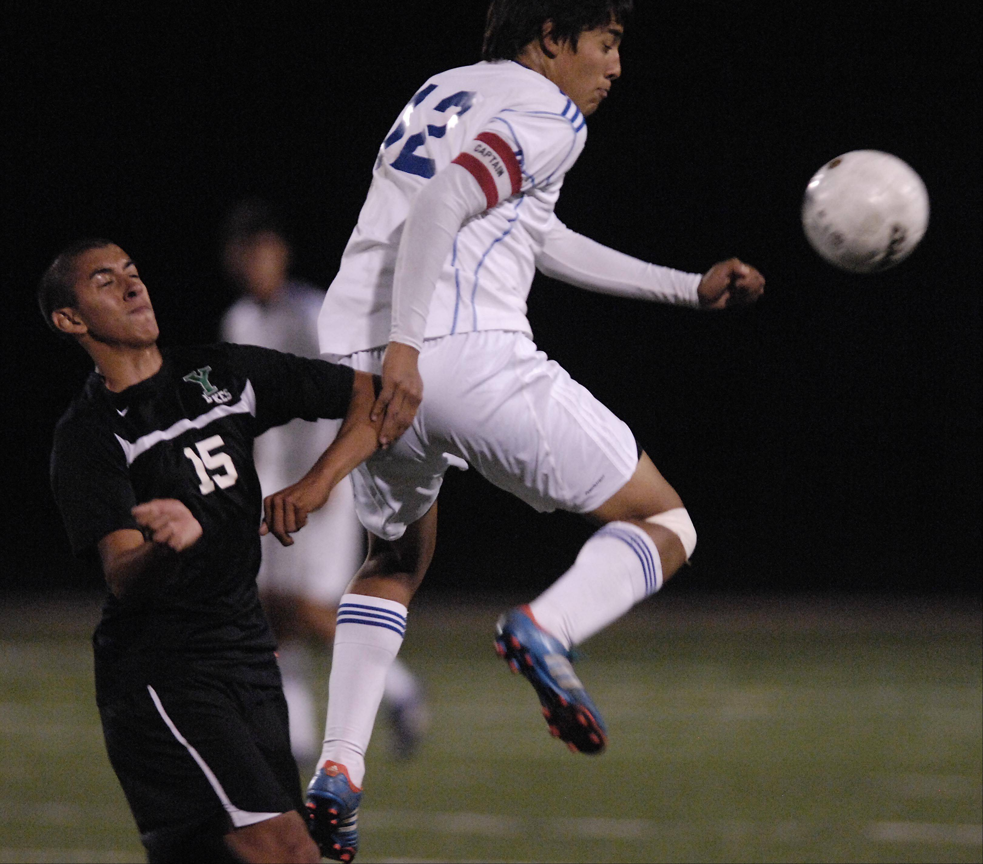 Larkin's Tony Hernandez gets to the ball before York's Danny Gordillo Tuesday in the Schaumburg regional playoff game.