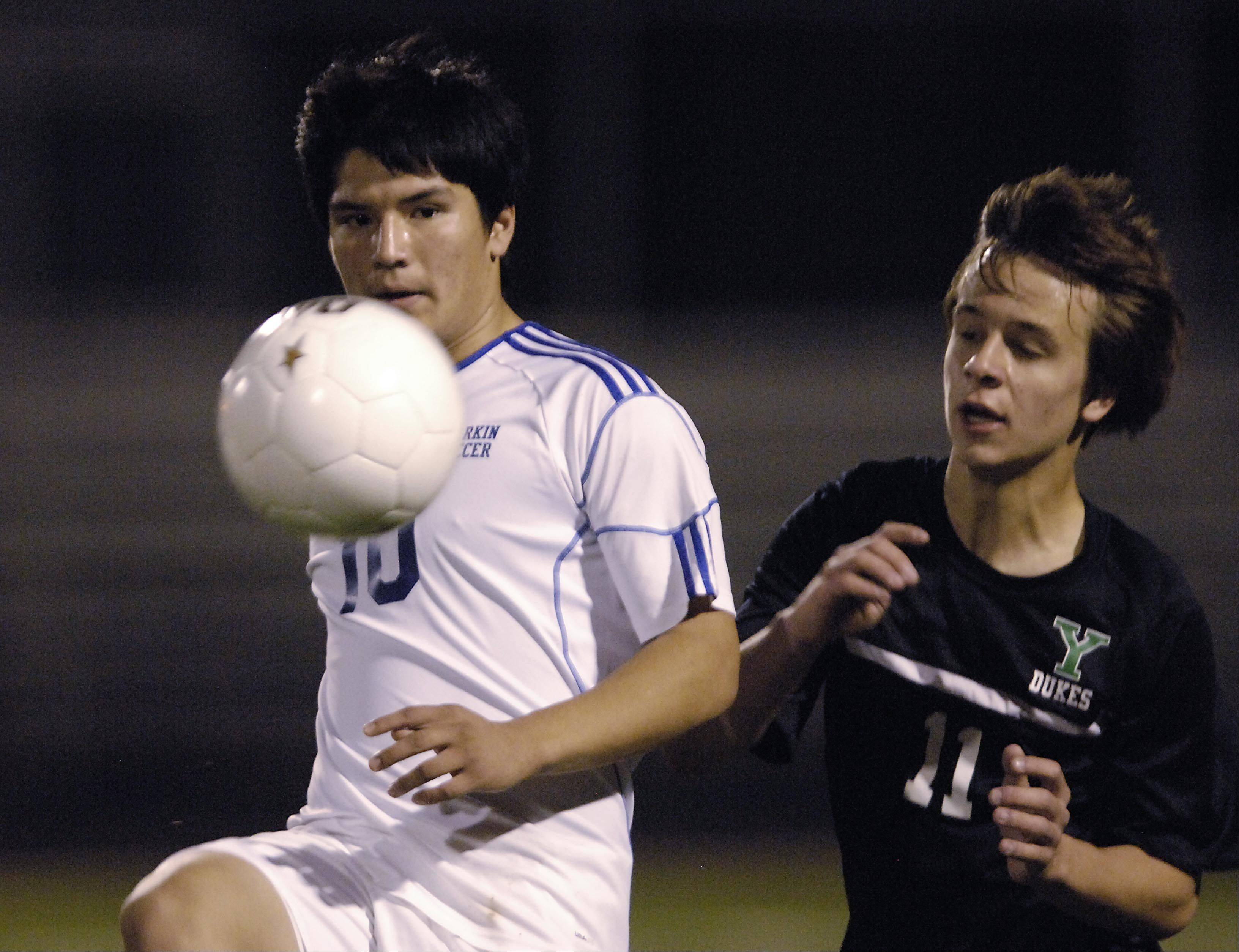 Larkin's Erik Rodriguez controls the ball against York's Nick Gaudio Tuesday in the Schaumburg regional playoff game. Rodriguez scored the last goal in the 3-1 Larkin win.