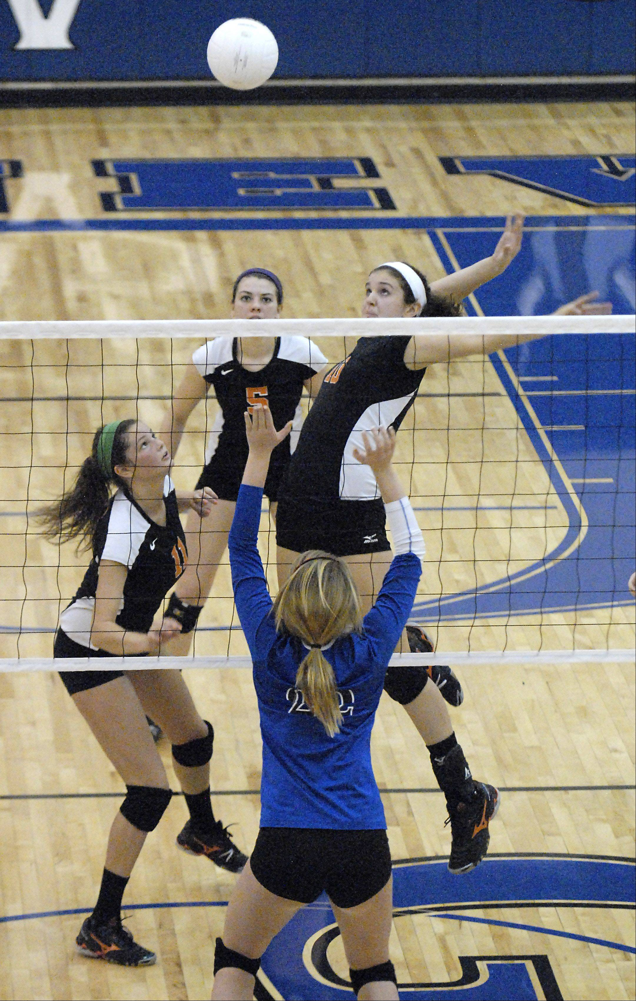 St. Charles East's Mikaela Mosquera winds up for a spike in game two on Tuesday, October 16.