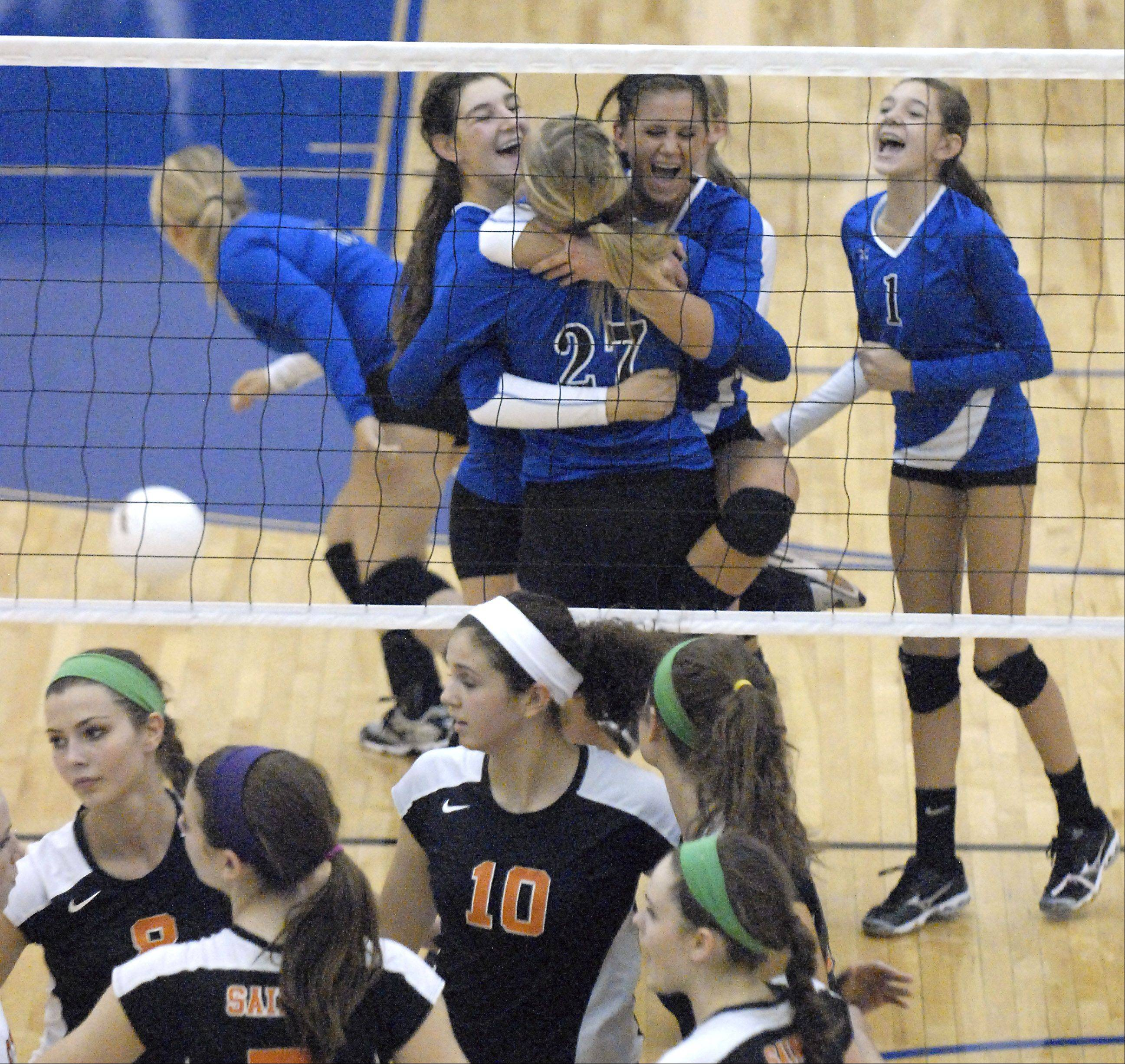 Geneva's Taylor Marmitt (27) is swarmed by teammates Jess Wicinski and Hannah Buck in game one on Tuesday, October 16.