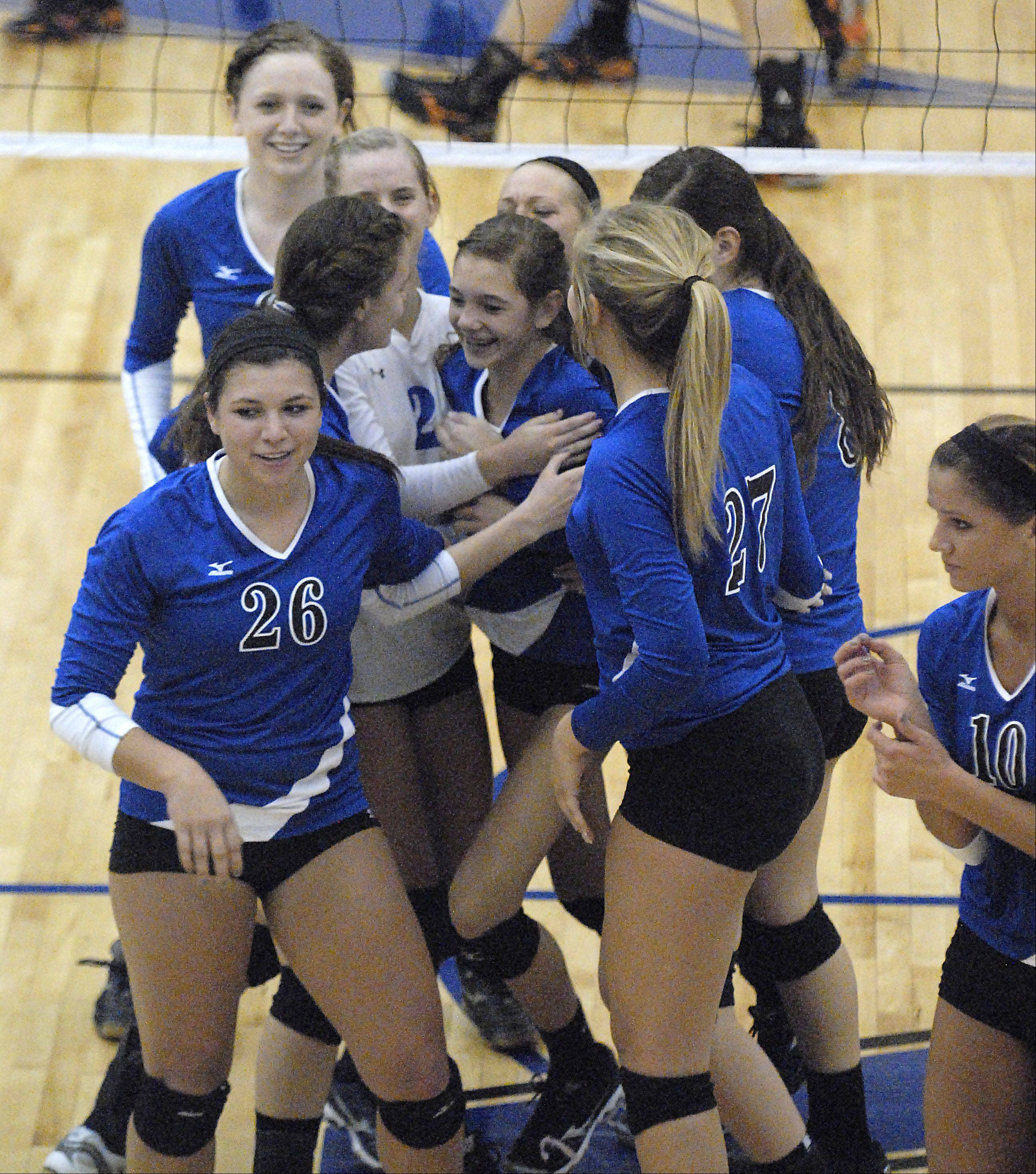 Laura Stoecker/lstoecker@dailyherald.comGeneva's Kelsey Wicinski is swarmed by teammates after the Vikings win game two over St. Charles East to even up the score on Tuesday, October 16.