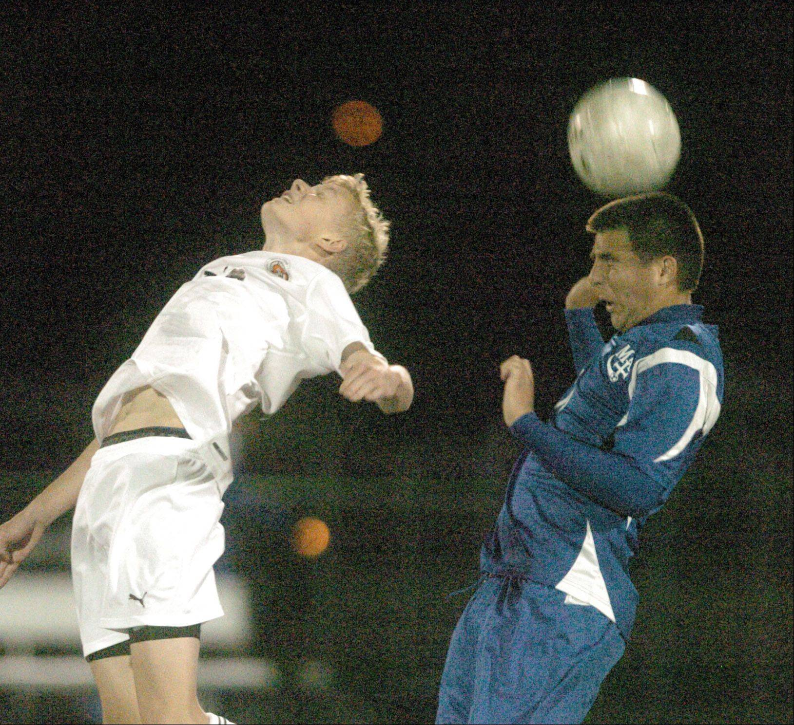 Patrick Nielsen of Wheaton Warrenville South and Claudio Jasso of Marmion go up for a ball during the Wheaton Warrenville South vs. Marmion game at Naperville North Tuesday.