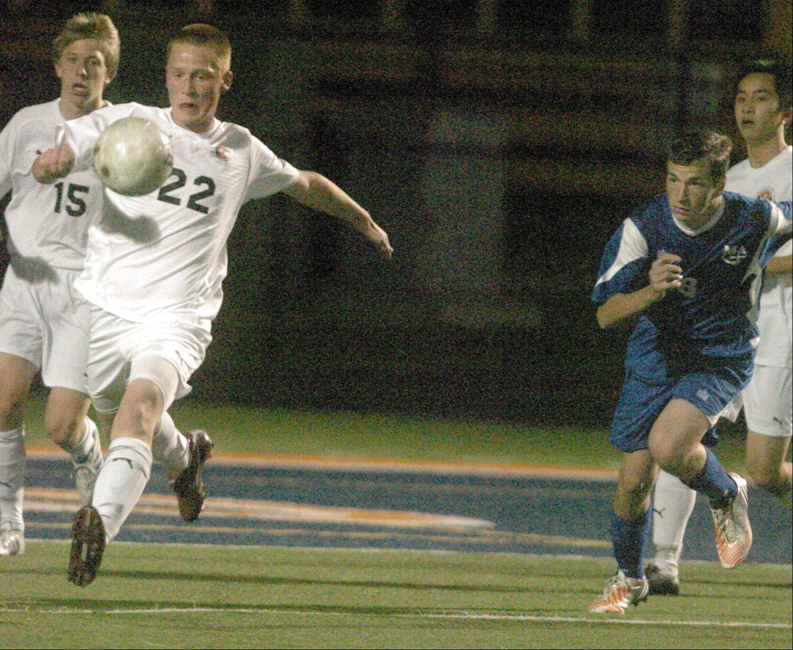 Mitchell Cin of Wheaton Warrenville is chased by Marmion defenders during the Wheaton Warrenville South vs. Marmion game at Naperville North Tuesday.