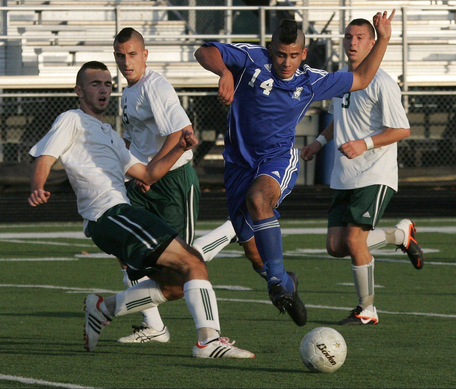 Lake Zurich midfielder Miguel Hernandez dribbles past several Stevenson players during Class 3A regional semifinal play Tuesday in Lincolnshire.