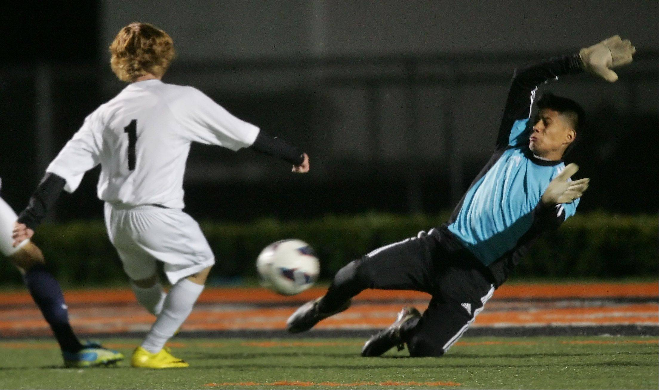 Libertyville midfielder Liam O'Connell shoots the ball past Round Lake goalie Jose Martinez to score the second goal of the game during the North Suburban Conference Championship Thursday.