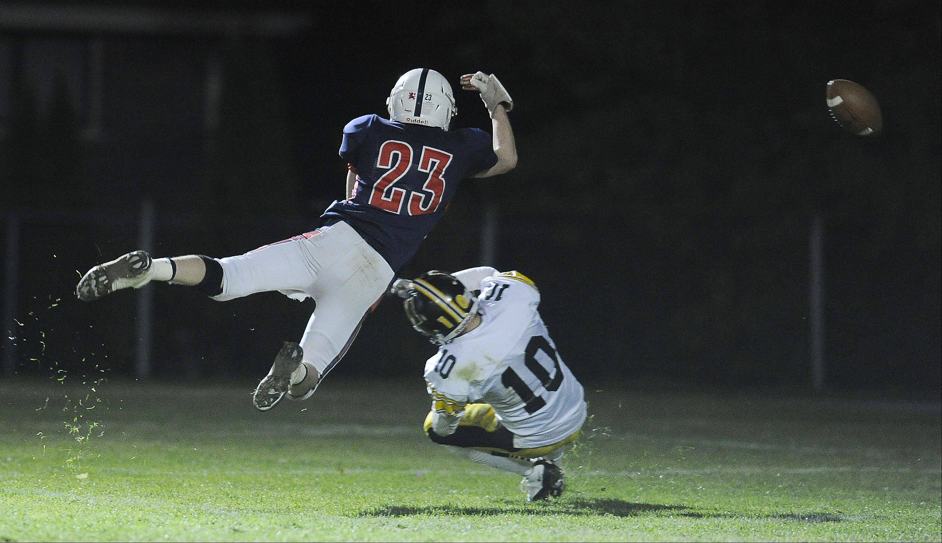 St. Viator's Kevin Hammarlund fails to haul in a catch under pressure from Marian Catholic's Patrick Swanson Friday at Forest View Educational Center in Arlington Heights.