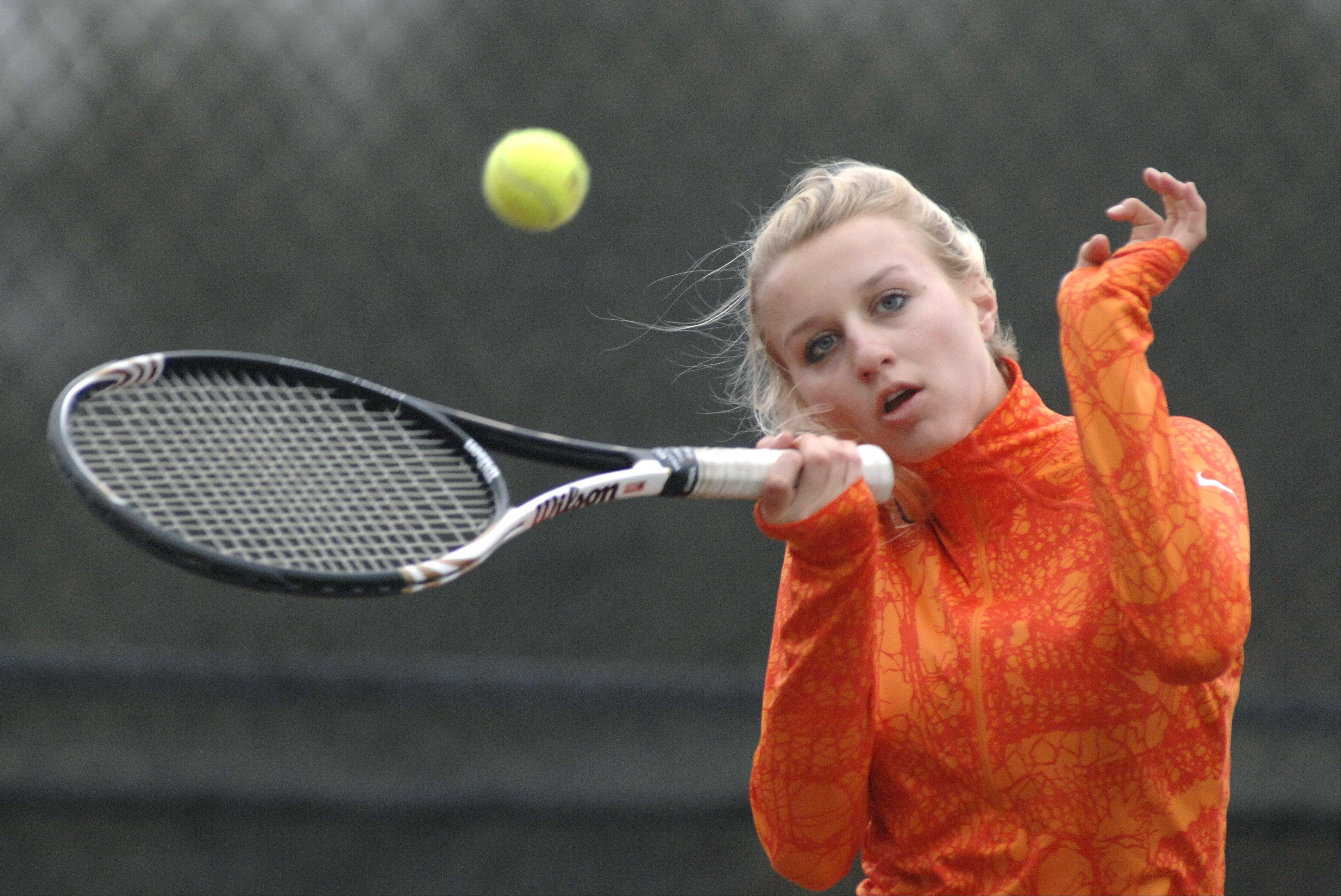 St. Charles East's Sarah Church competes in a singles semi-finals match during Saturday's tennis sectional in St. Charles.