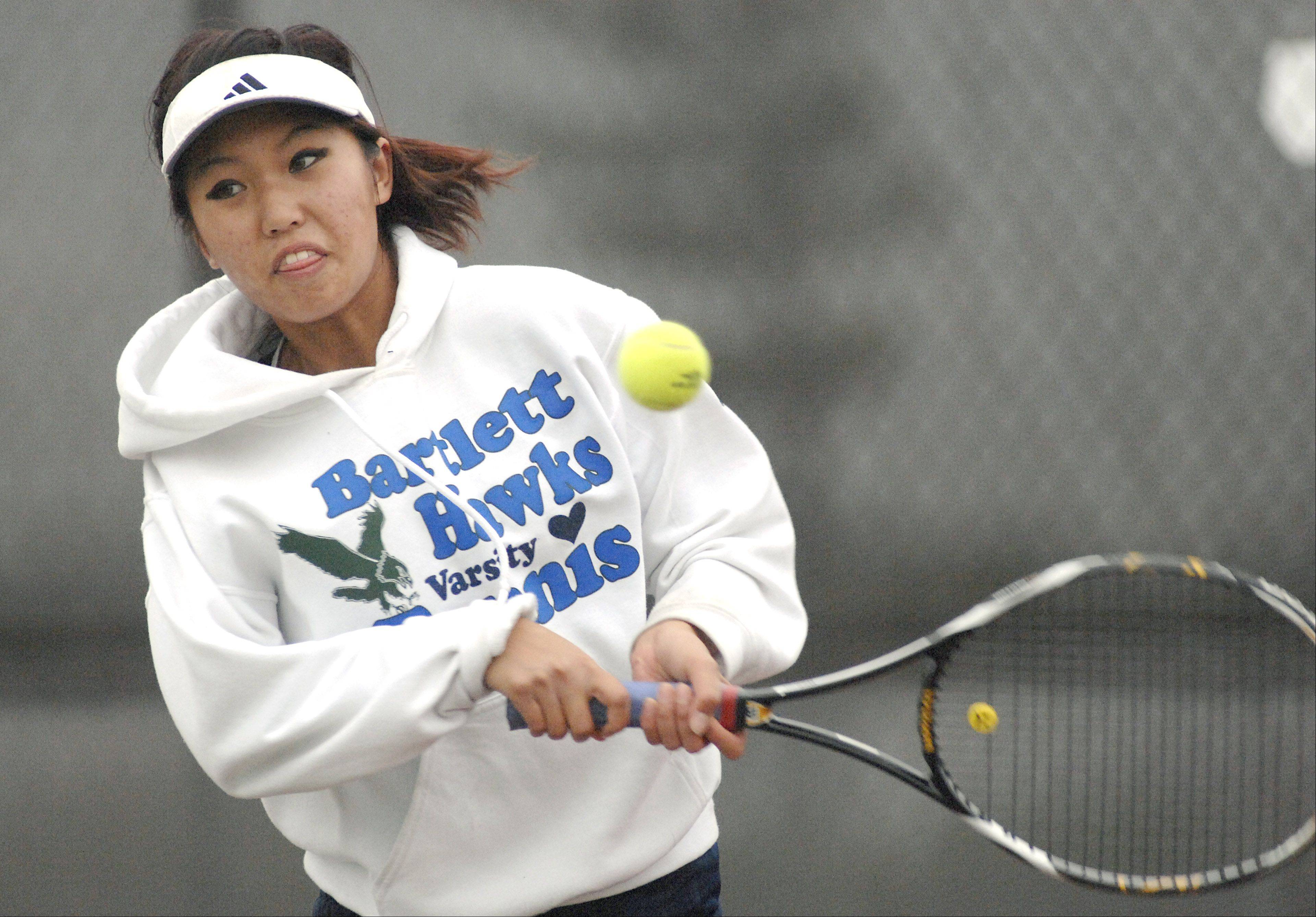 Bartlett's Jitsupa Sirihit competes in a doubles semi-finals match during Saturday's tennis sectional in St. Charles.