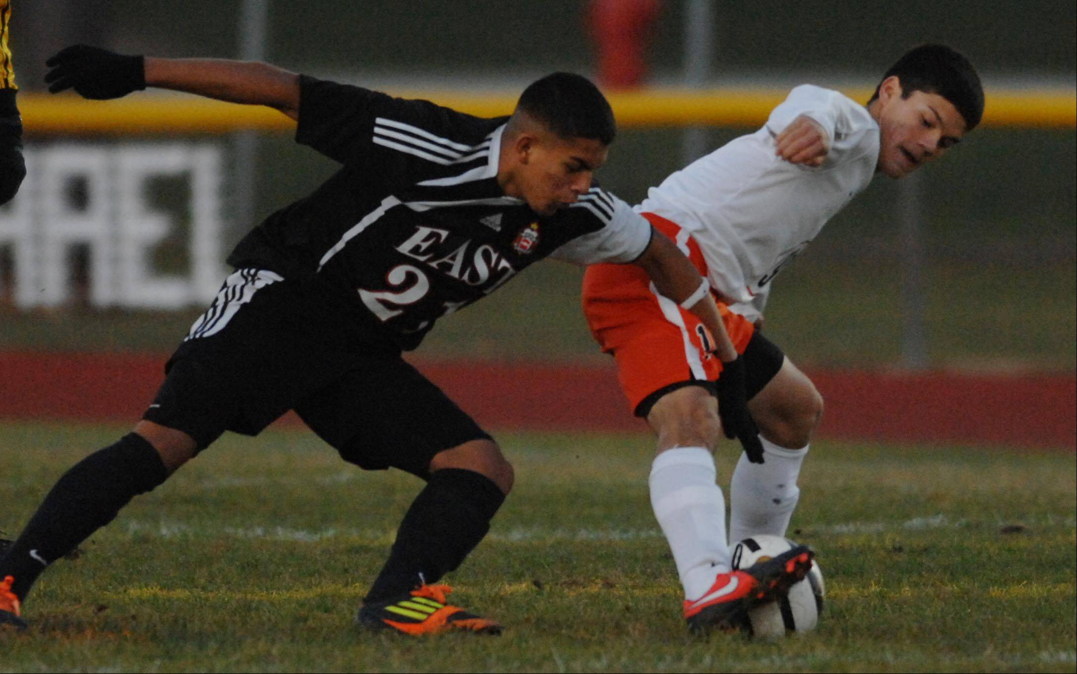 St. Charles East's Kevin Kurtz and East Aurora's Danny Miranda battle Wednesday during the Upstate Eight boys soccer championship game at St. Charles East.