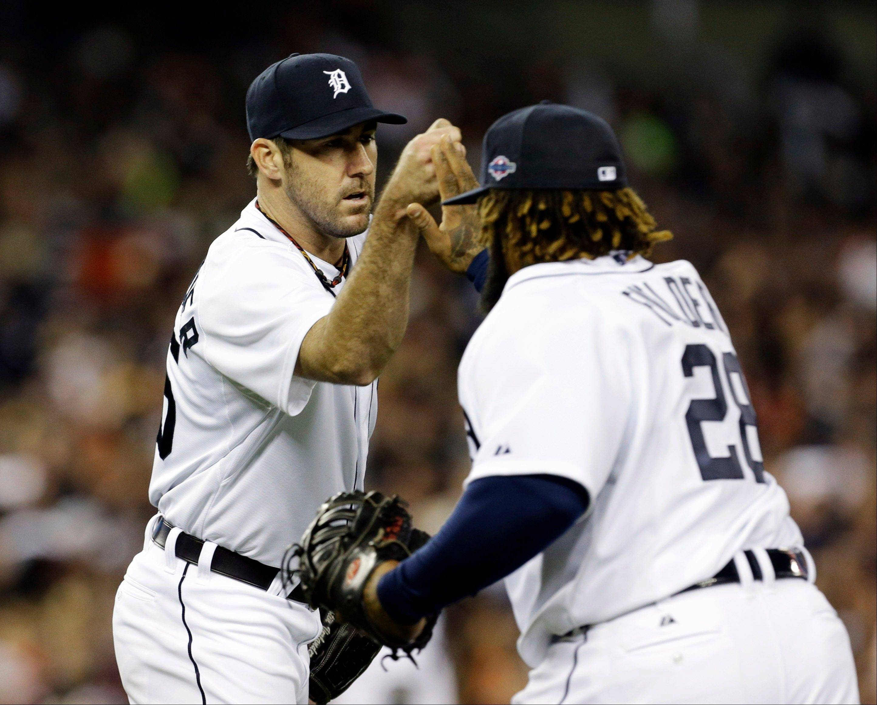 Detroit Tigers pitcher Justin Verlander congratulates first baseman Prince Fielder Tuesday after New York Yankees' Raul Ibanez grounded out to Fielder in the seventh inning during Game 3 of the American League championship series in Detroit.