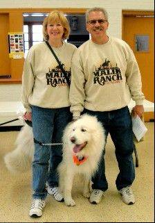 Pam and Peter Malik and Bear, a Great Pyrenees.
