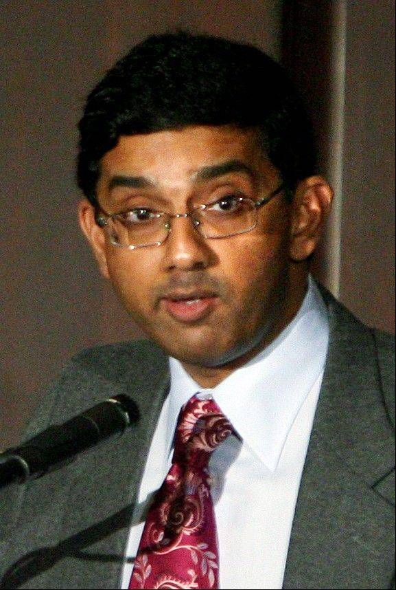 Dinesh D�Souza, the conservative scholar behind a high-grossing documentary that condemns President Barack Obama, is under investigation by the evangelical college he leads over a report he took a woman who is not his wife to an event on Christian values.