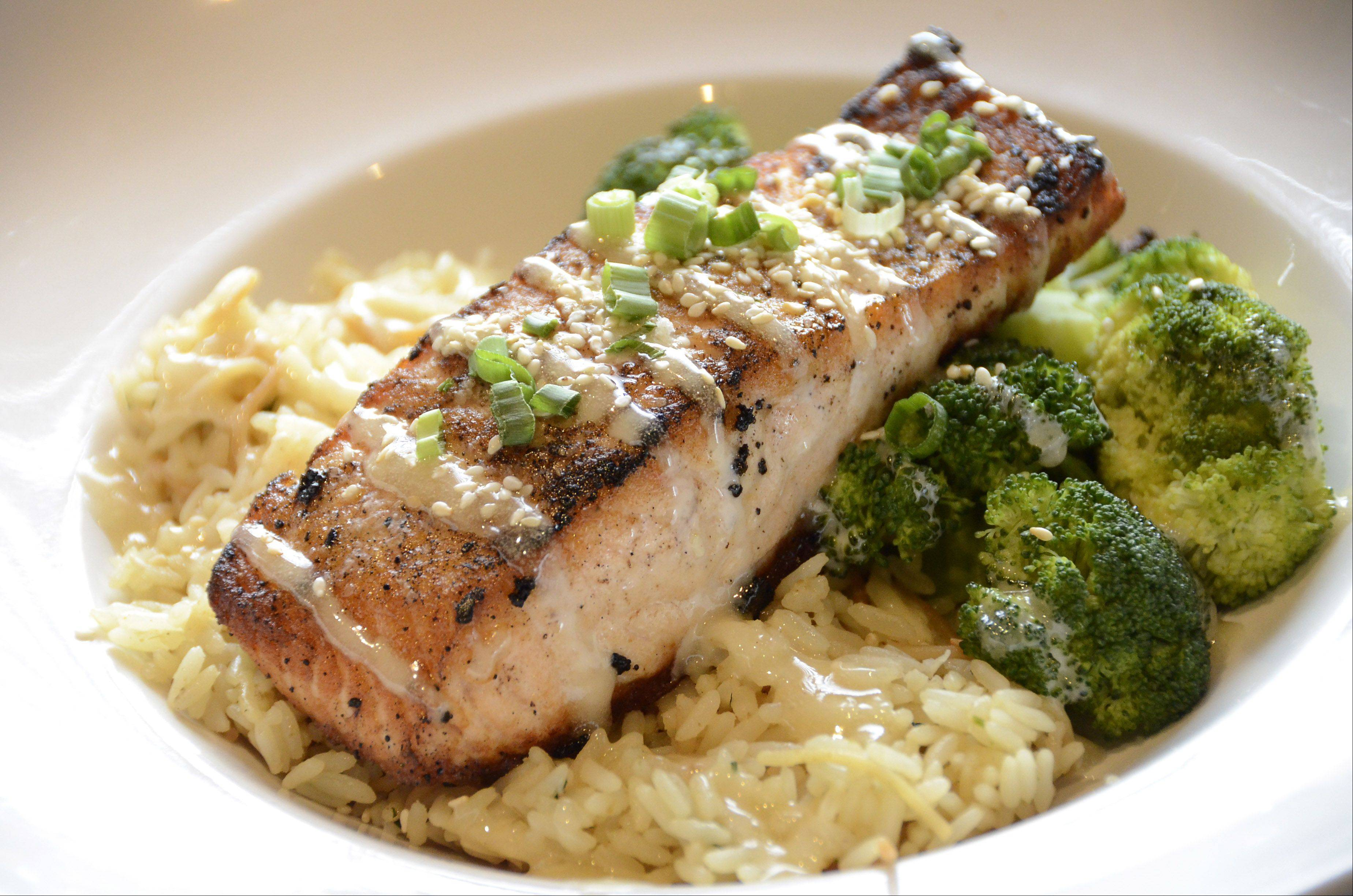 The Catch of the Day changes daily at BlackFinn American Grill in Randhurst Village in Mount Prospect. This selection is Sesame Salmon with Sweet Asian Dressing over rice and broccoli.