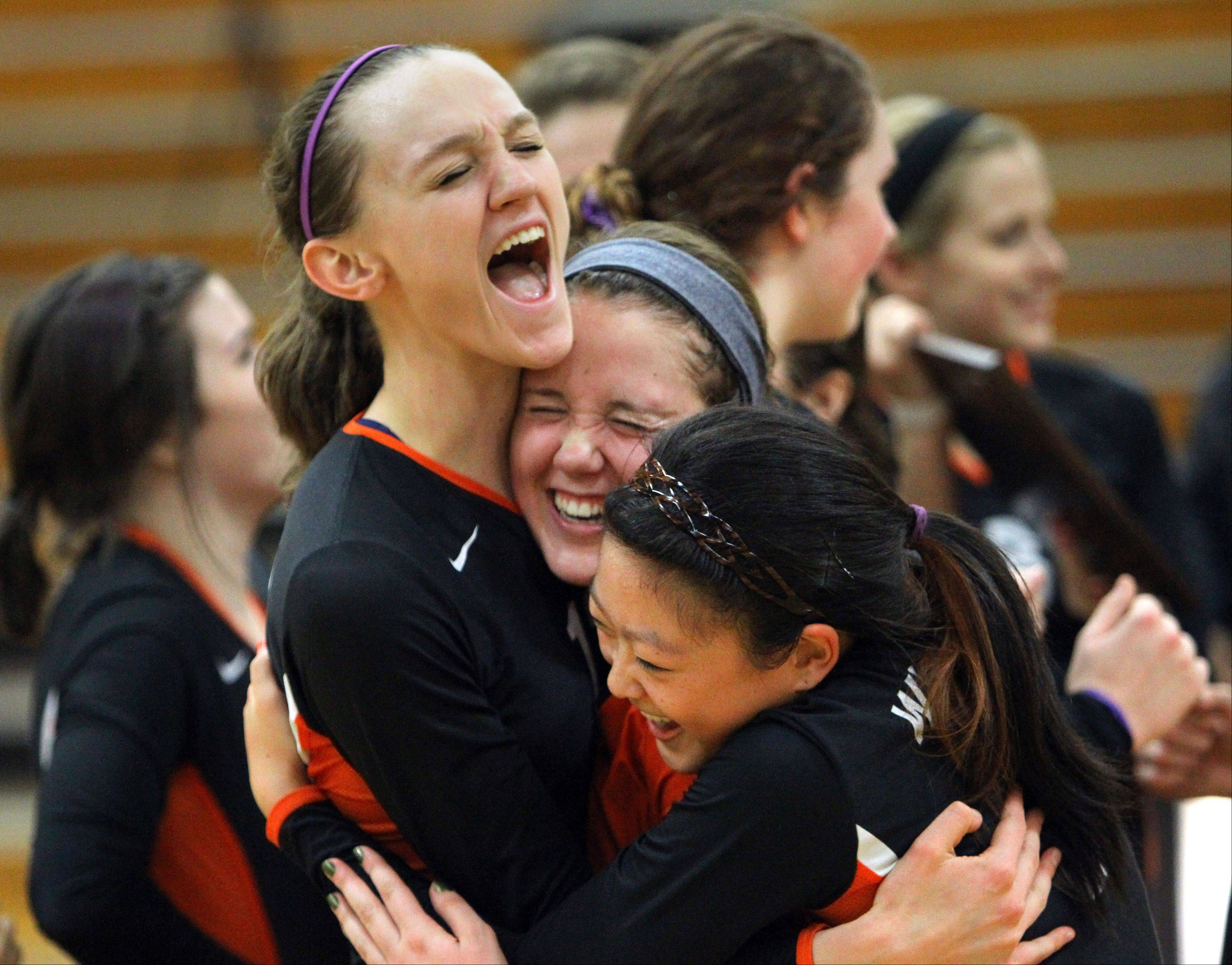 Libertyville�s Julia Smagacz, left, Kristen Webb, and Vicky Liu celebrate after beating Lakes to win the NSC title Wednesday night at Libertyville.