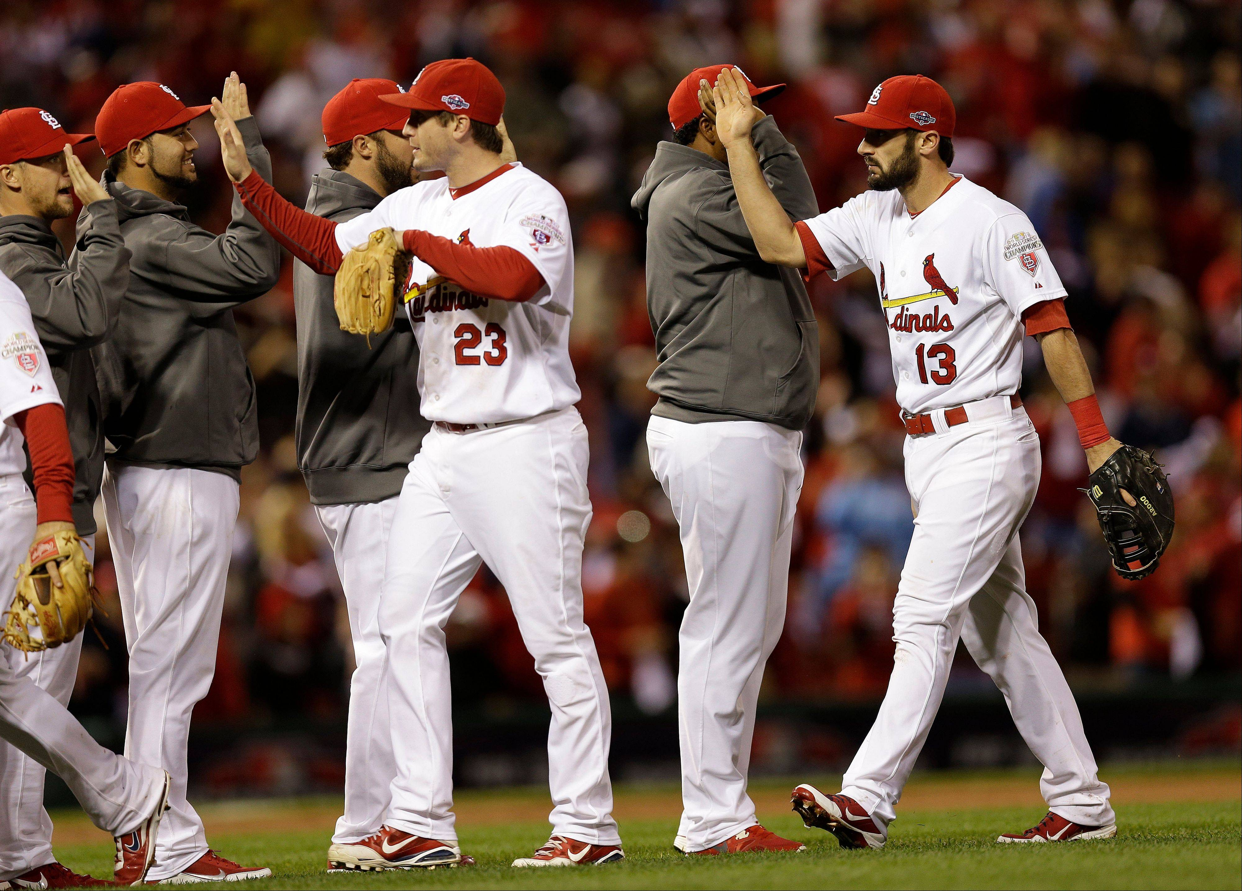 St. Louis Cardinals players celebrate after beating the San Francisco Giants 3-1 in Game 3 of baseball's National League championship series Wednesday, Oct. 17, 2012, in St. Louis. (AP Photo/David J. Phillip)