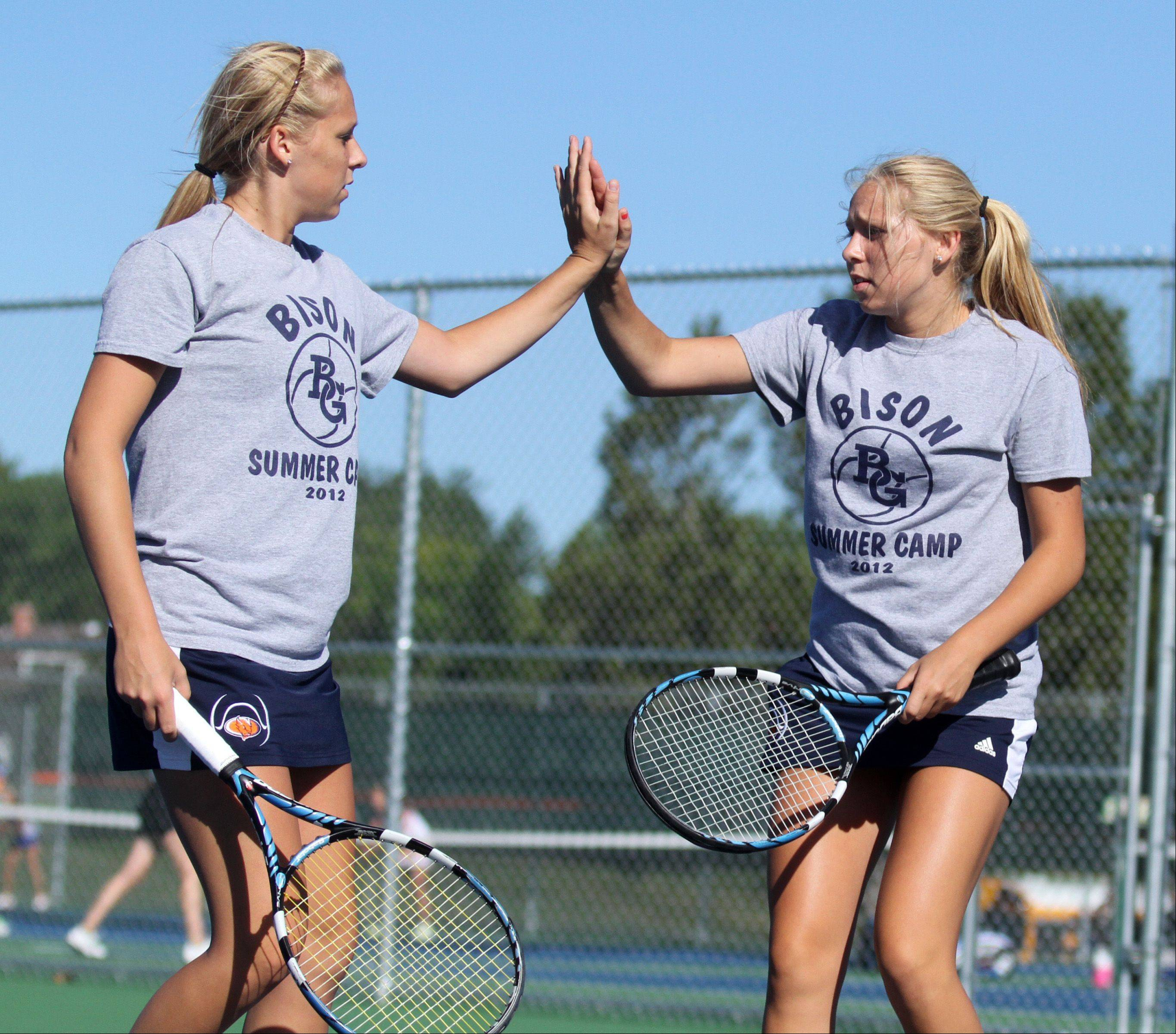 Buffalo Grove twins Dana, foreground, and Lauren Goggin wrap a standout high school tennis career in doubles play as the Bison host the state tournament this weekend.