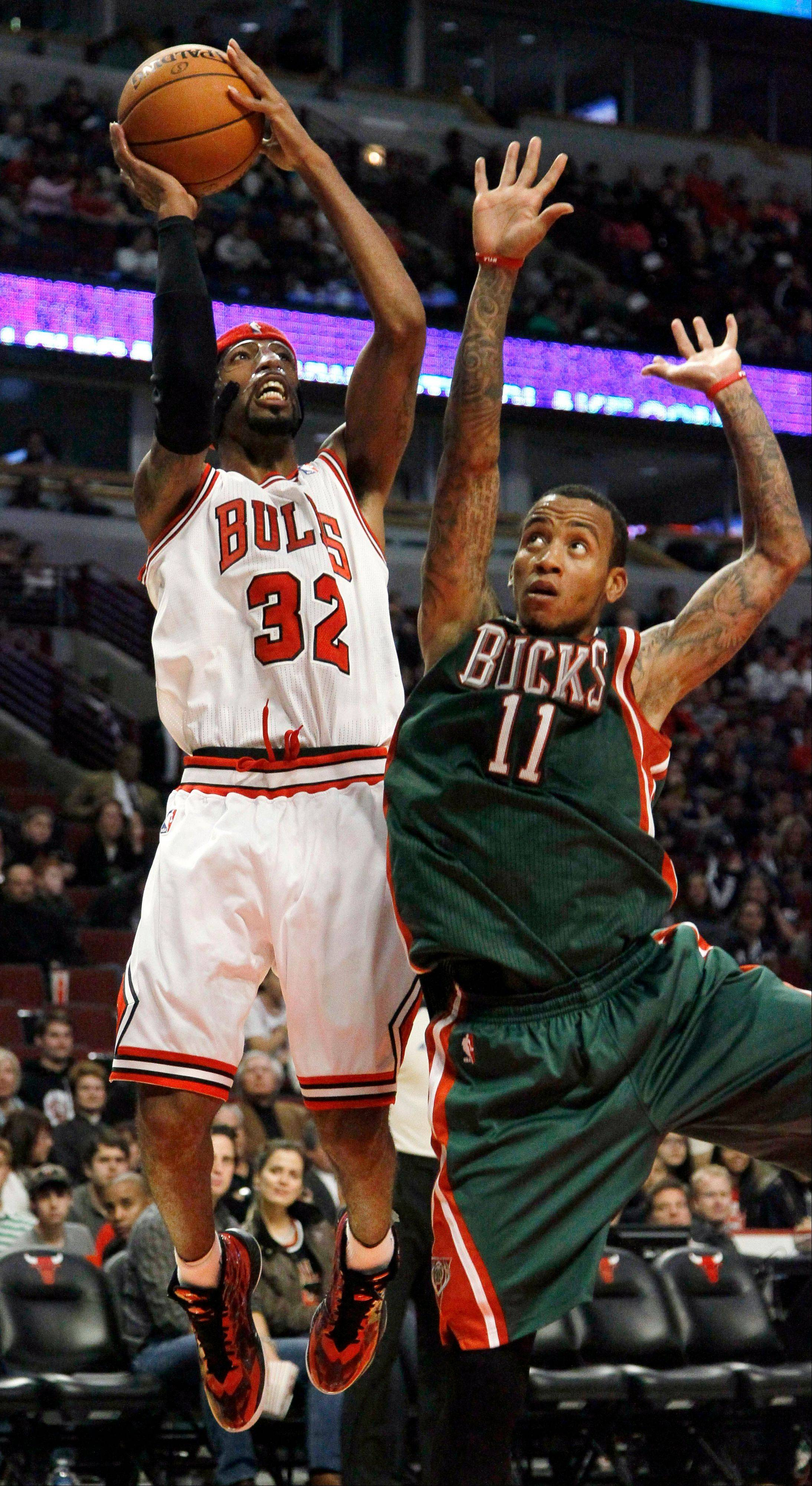 Bulls guard Richard Hamilton shoots over the Bucks� Monta Ellis during the second half of Tuesday�s preseason game.