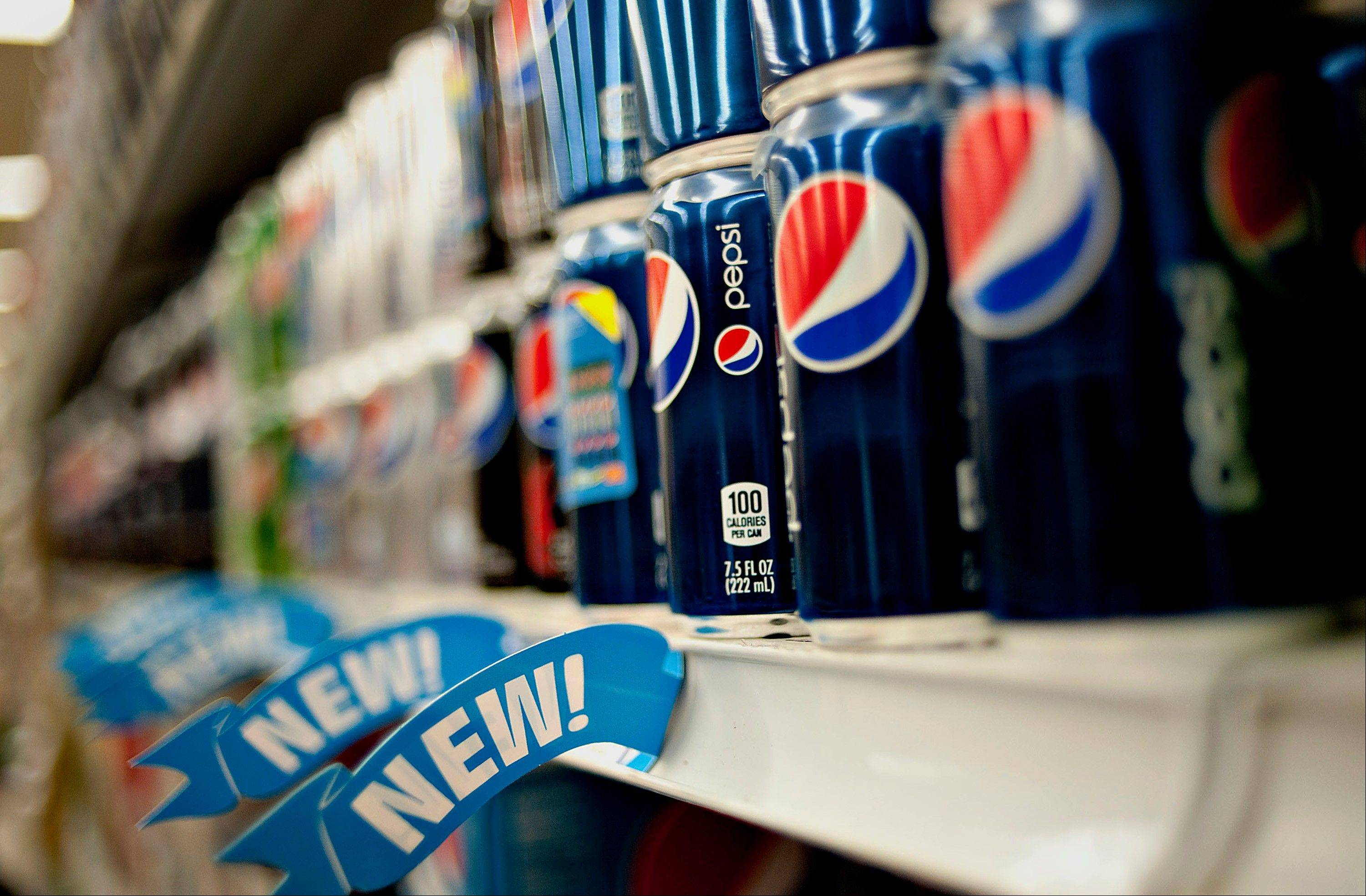 PepsiCo Inc. says its net income dipped 5 percent in the third quarter, as the food and beverage maker continued to pour more money into marketing to bolster its flagship brands.
