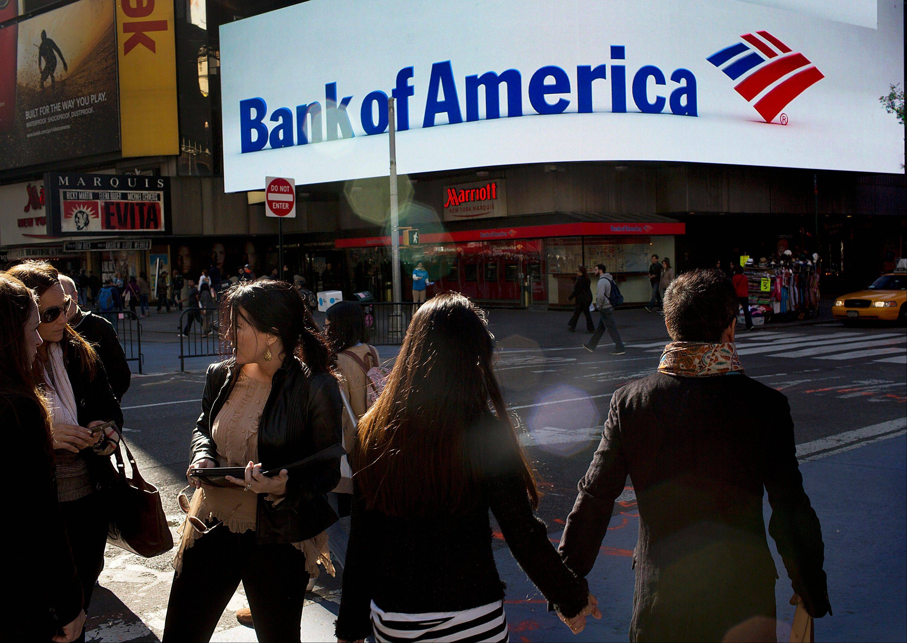 Pedestrians walk past a Bank of America Corp. branch in New York, U.S., on Tuesday, Oct. 16, 2012. Bank of America Corp. is scheduled to release earnings data on Oct. 17. Photographer: Victor J. Blue/Bloomberg
