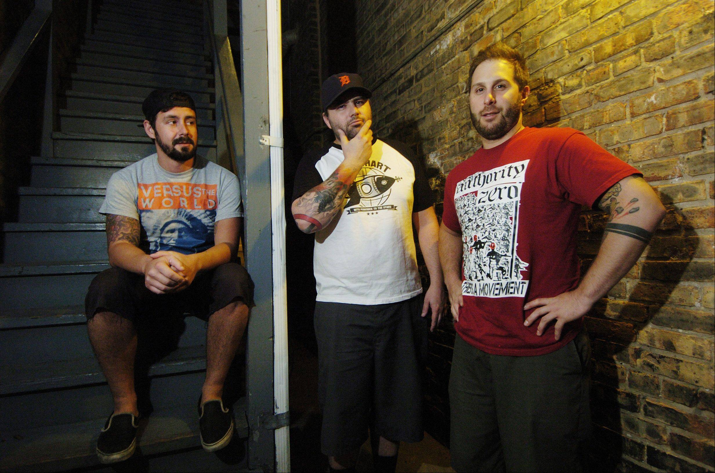 "JOE LEWNARD/jlewnard@dailyherald.comMembers of the punk band Counterpunch pose outside the Atlas Studio in Chicago while recording their new EP, ""Bruises."" Band members, from left to right, are Brian Phee of Oak Lawn, Jared Rohde of Fox River Grove and Eric Hausser of Palatine. Not pictured is drummer Jim Margle of suburban Detroit."