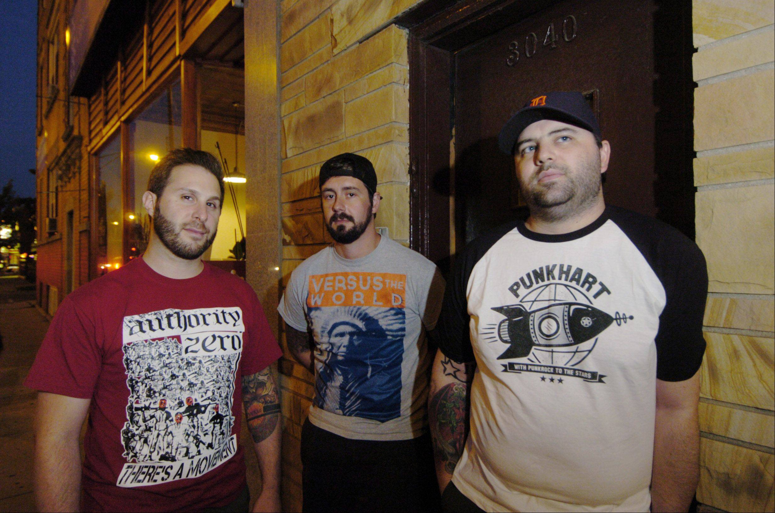"JOE LEWNARD/jlewnard@dailyherald.com Members of the punk band Counterpunch pose outside the Atlas Studio in Chicago while recording their new EP, ""Bruises."" Pictured, from left to right, are Eric Hausser, Brian Phee and Jared Rohde. Not pictured is drummer Jim Margle of suburban Detroit."