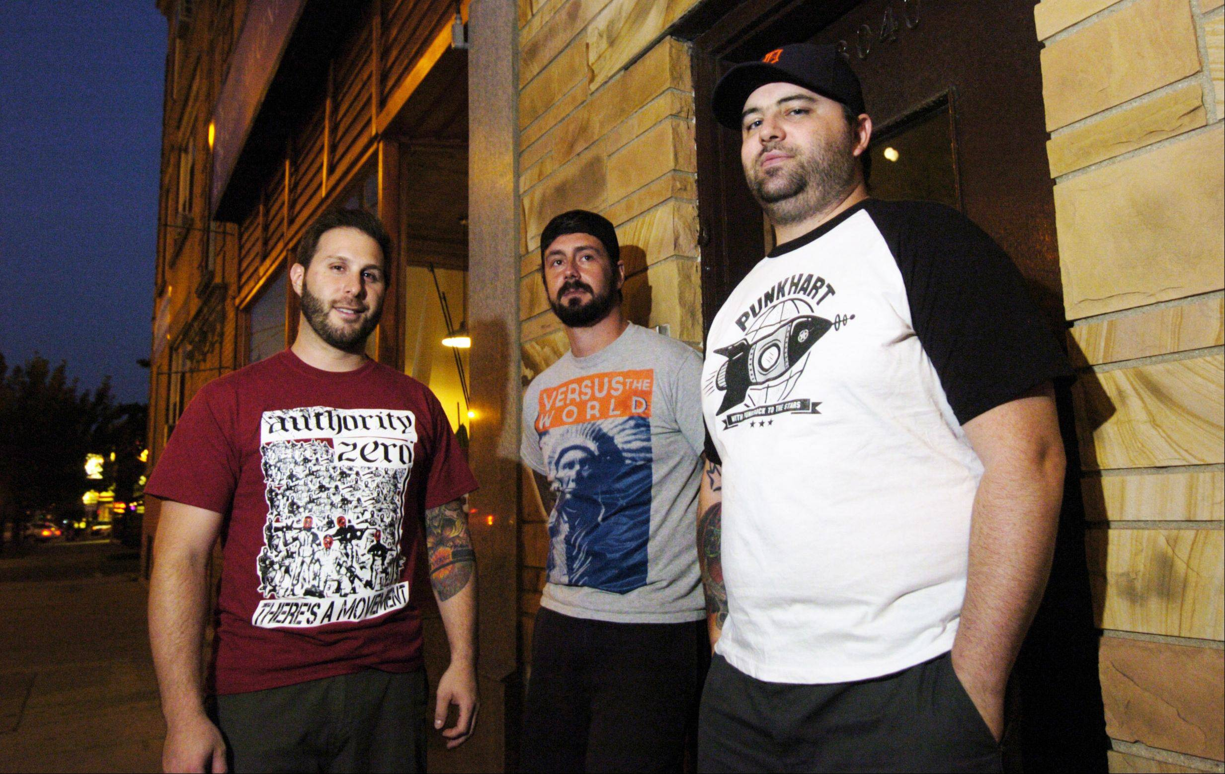 "Members of the punk band Counterpunch pose outside the Atlas Studio in Chicago while recording their new EP, ""Bruises."" Pictured, from left, are Eric Hausser, Brian Phee and Jared Rohde."