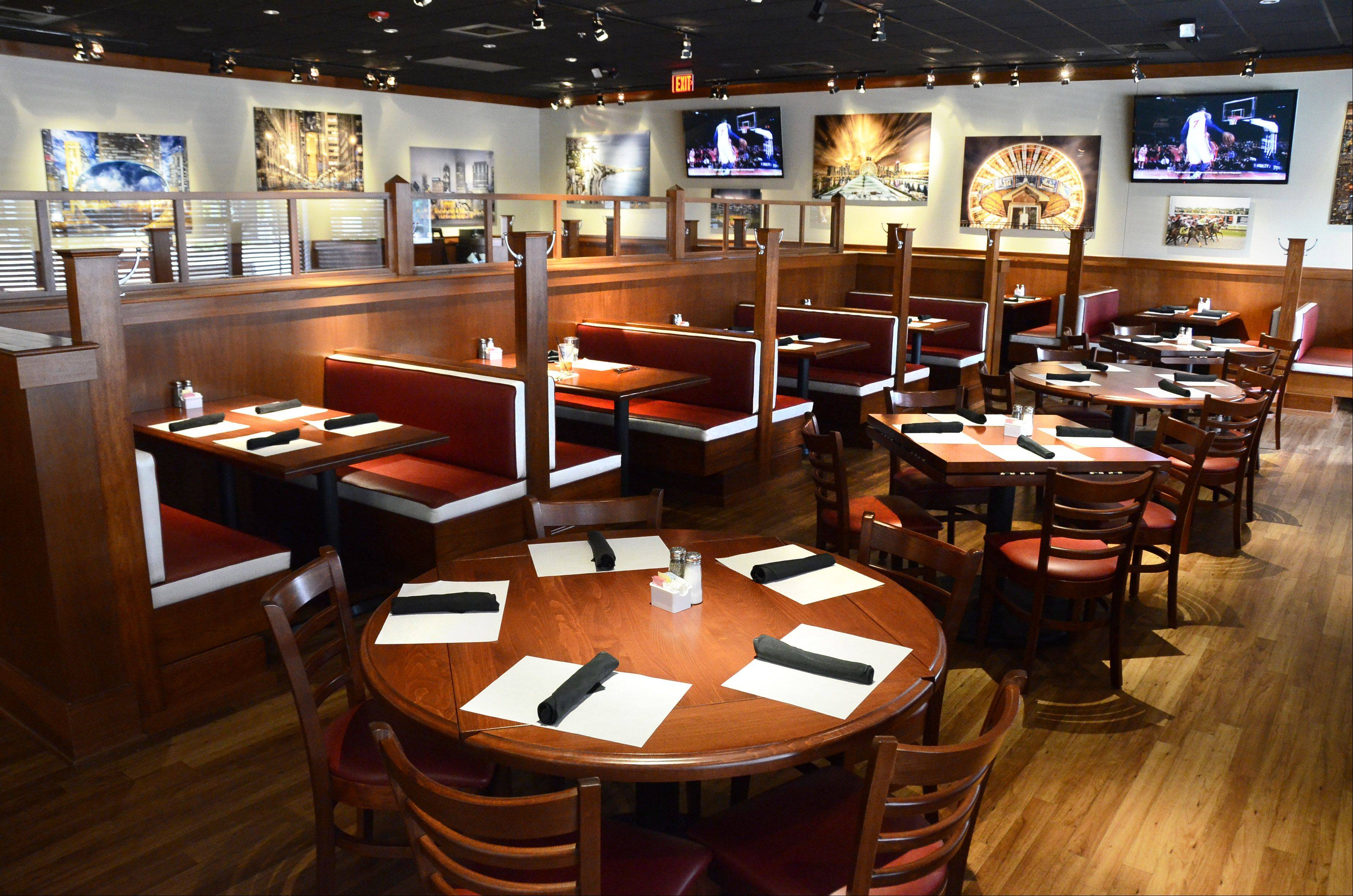 The dining room at BlackFinn American Grill at Randhurst Village features warm woods and cozy booths.