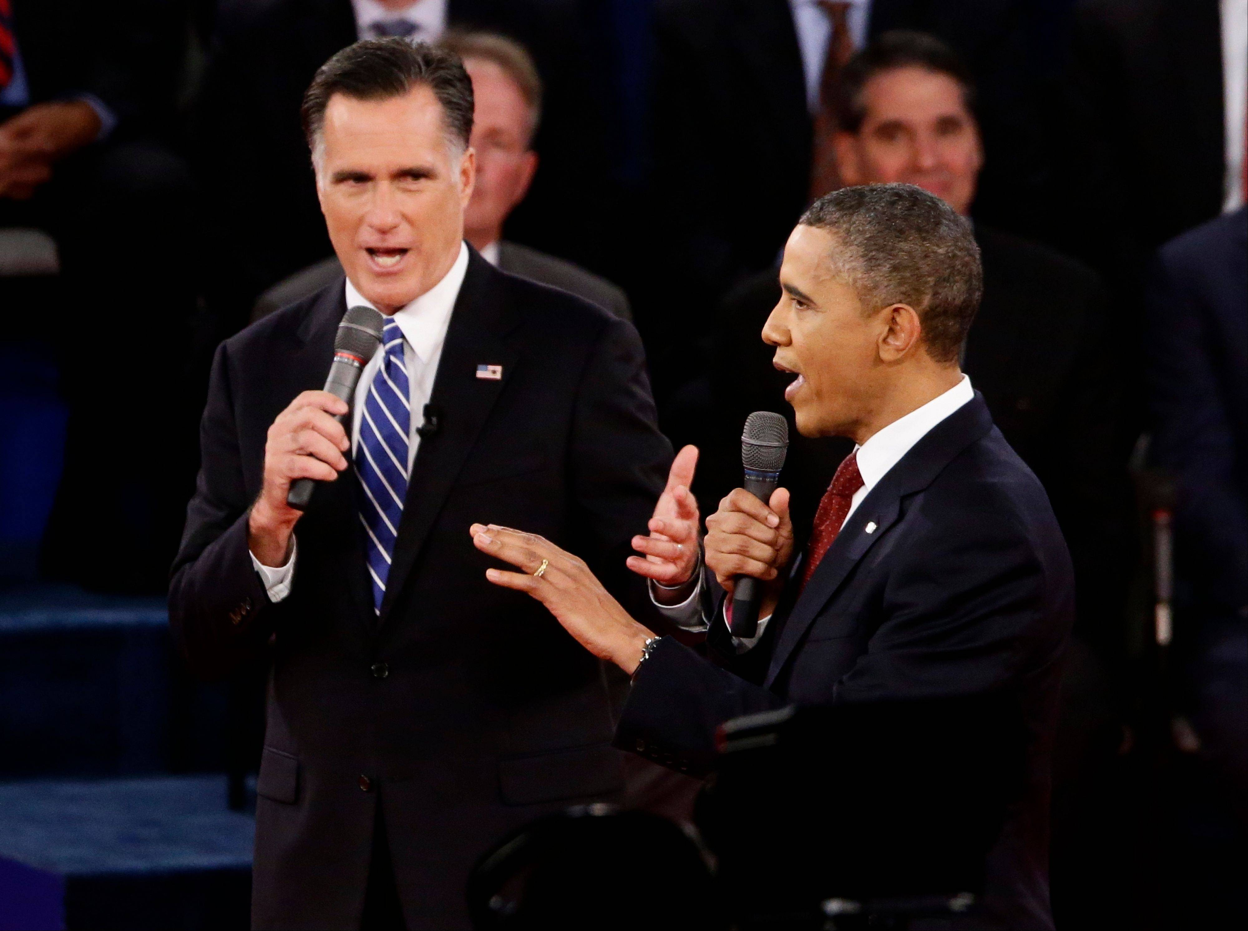 President Barack Obama and Republican presidential candidate and former Massachusetts Gov. Mitt Romney debate at Hofstra University in Hempstead, N.Y., Tuesday.