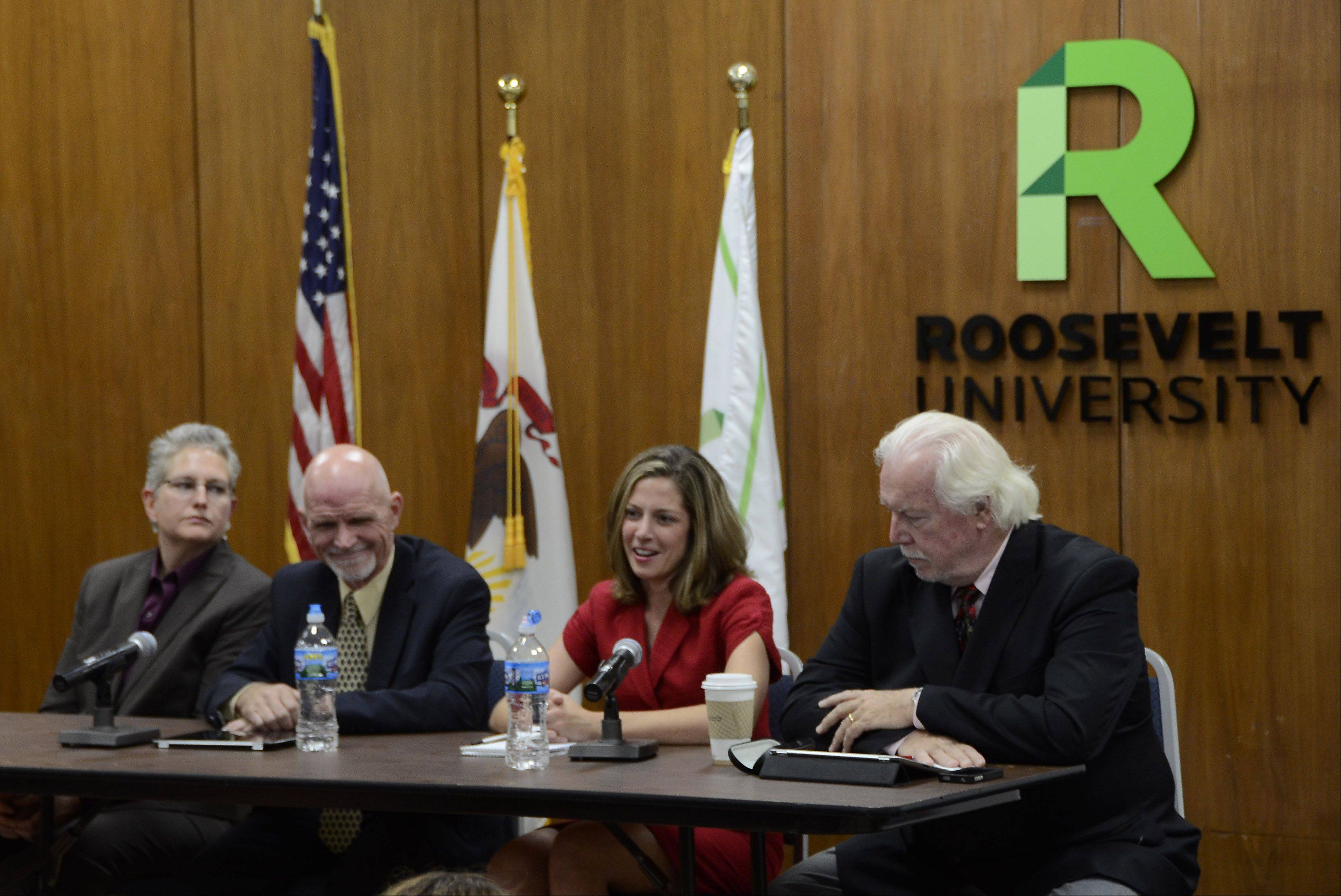 Panel members, from left, Madeleine Doubek, chief operating officer of Reboot Illinois, the Daily Herald's Jim Slusher, assistant managing editor/opinion page, Kerry Lester, political editor and Charles Madigan, a journalist for 40 years before joining Roosevelt University as presidential writer-in-residence take questions during a Daily Herald Subscriber Total Access political forum at Wednesday at the Schaumburg Campus of Roosevelt University.