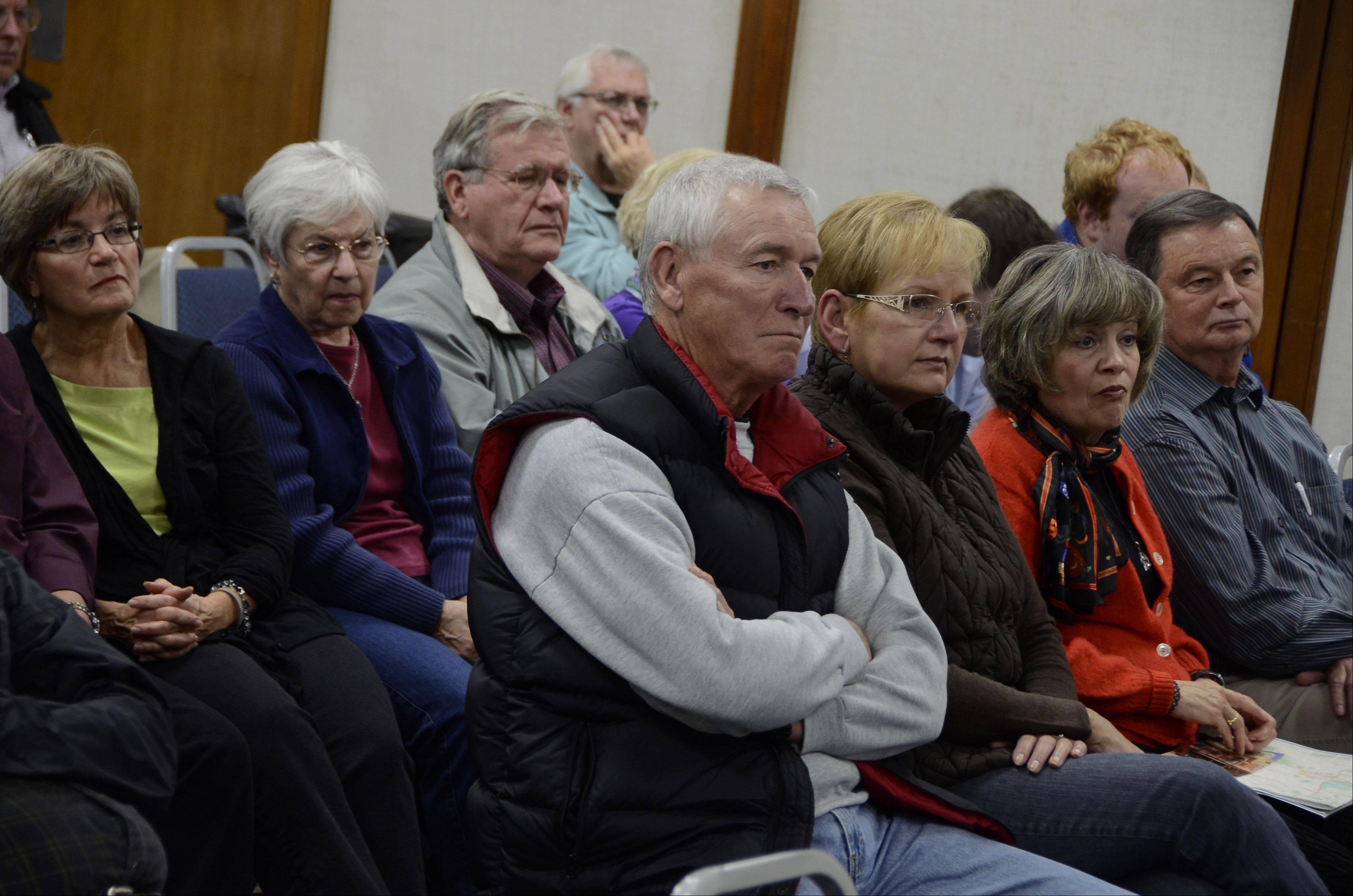 Bill Zars/bzars@dailyherald.comThe audience listens closely during a Daily Herald Subscriber Total Access political forum at Wednesday at the Schaumburg Campus of Roosevelt University.