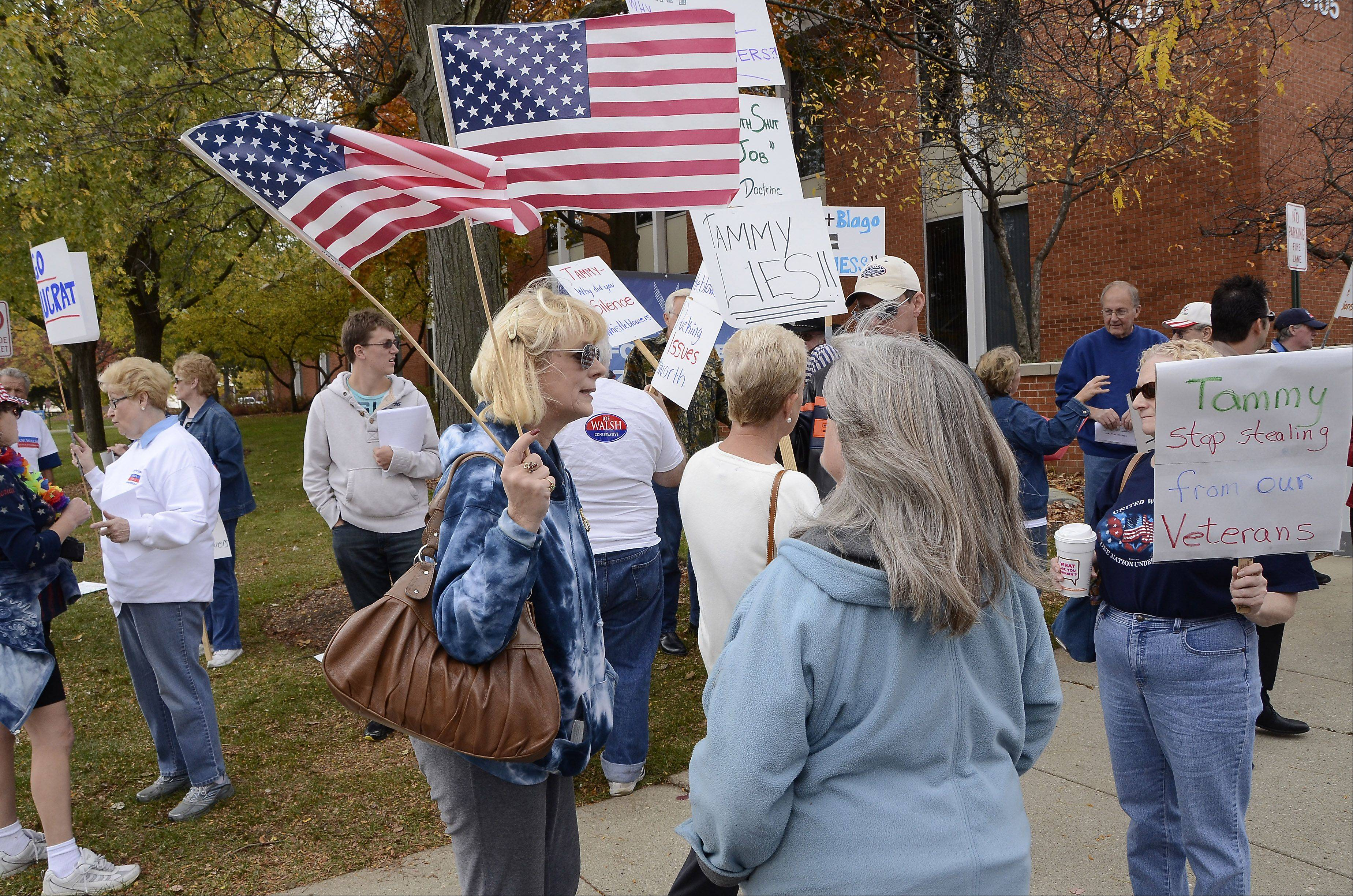 About 25 supporters of Republican Congressman Joe Walsh protest outside the office of Democratic opponent Tammy Duckworth Wednesday afternoon in Rolling Meadows.