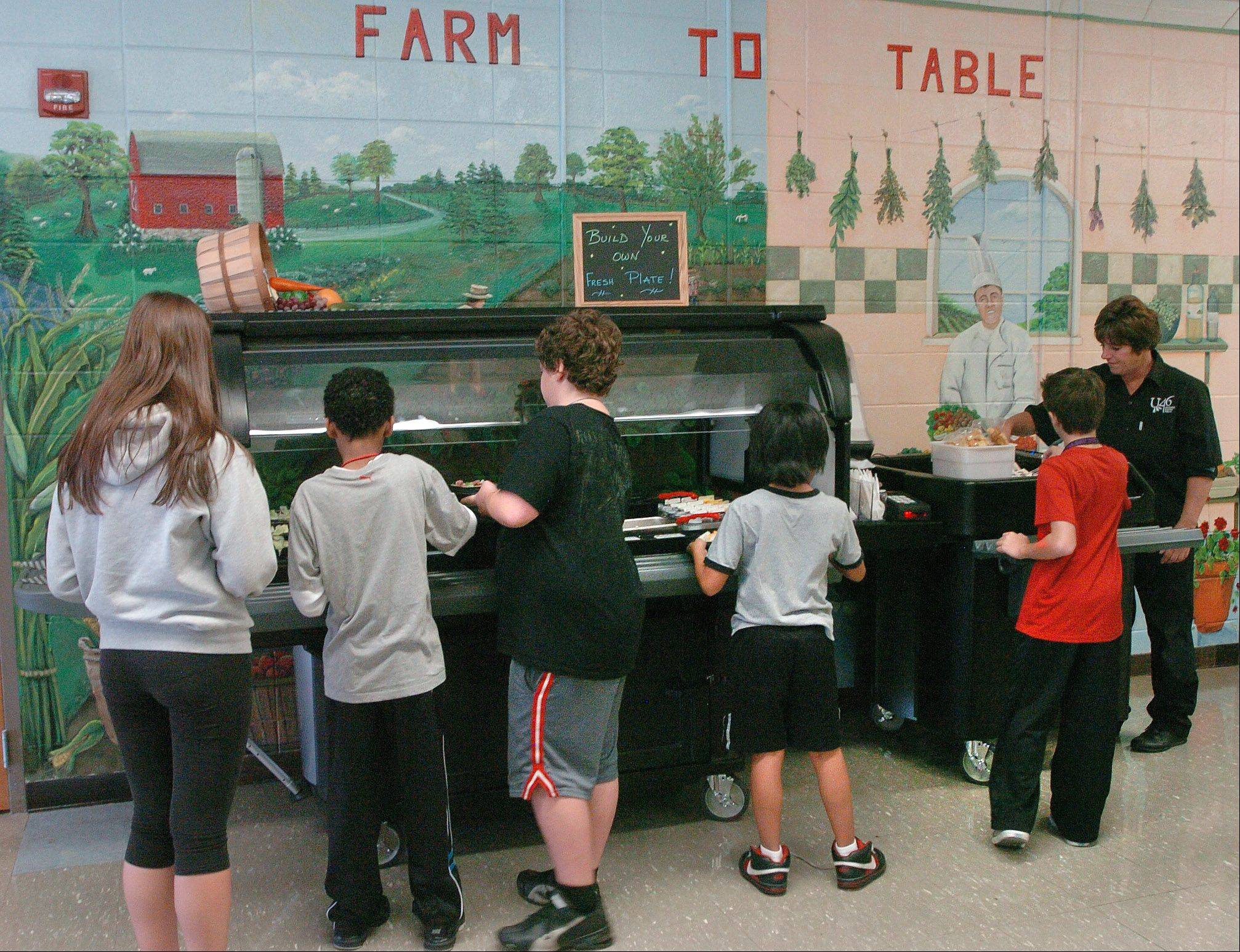 A salad cart at Eastview Middle School in Bartlett is part of a program at Elgin Area School District U-46 schools to get healthier foods into school cafeterias.