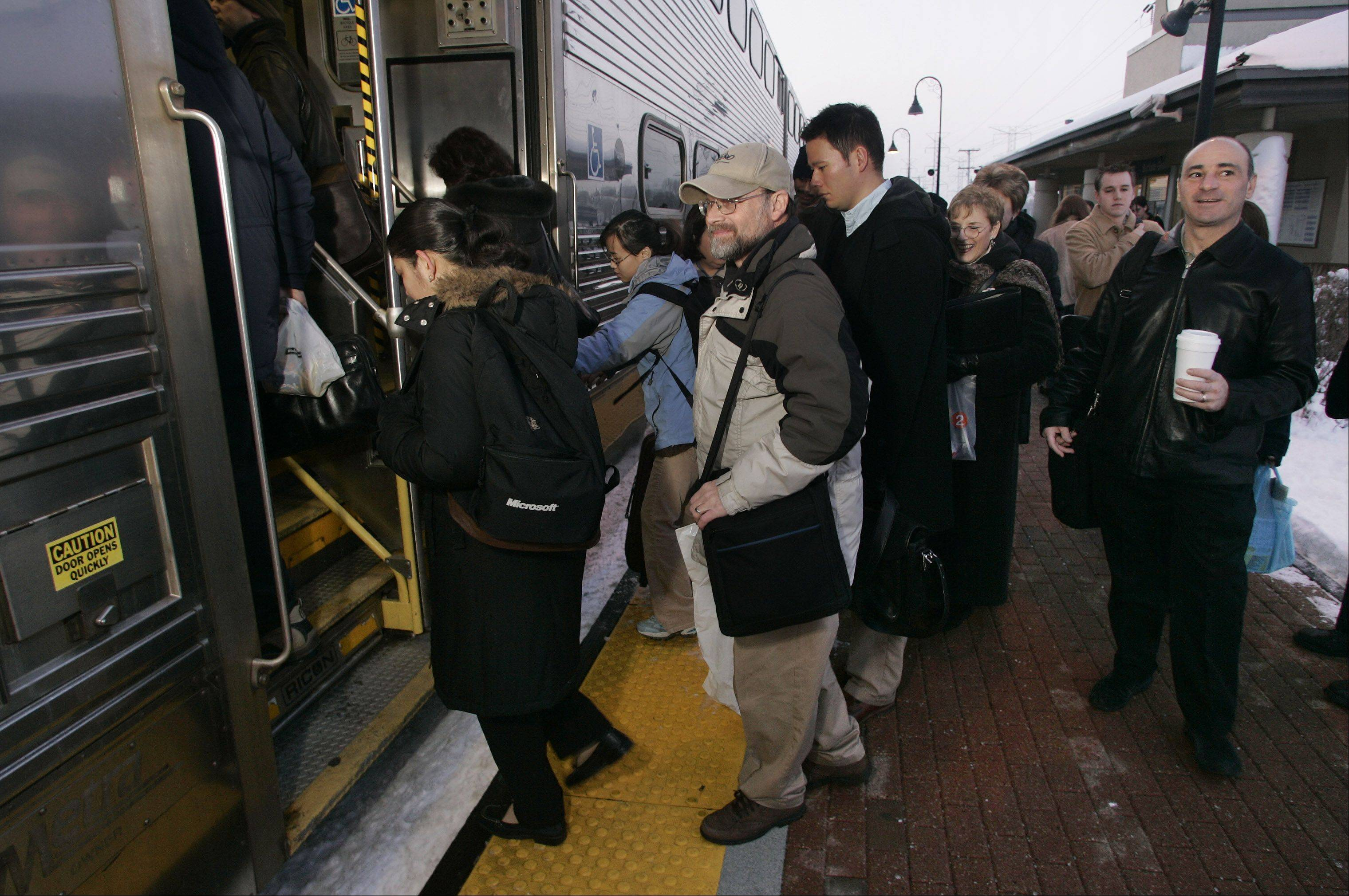Passengers board the Metra commuter train at the Buffalo Grove Metra station. A study suggests pursuing housing opportunities that would appeal to younger populations in the area around the train station.