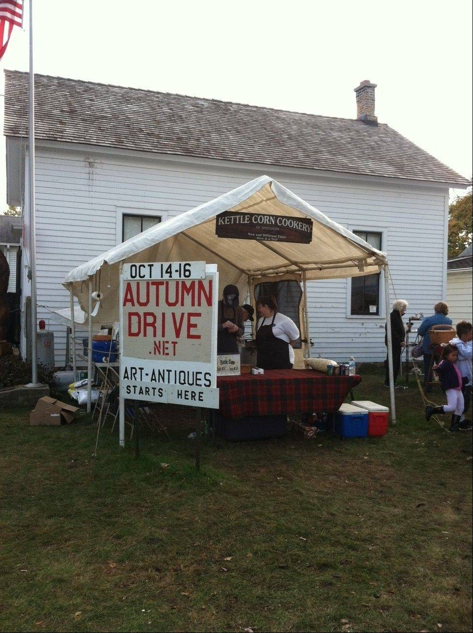 Visitors to the McHenry County Autumn Drive can pick up some kettle corn before heading into Perkins Hall to view historical exhibits.