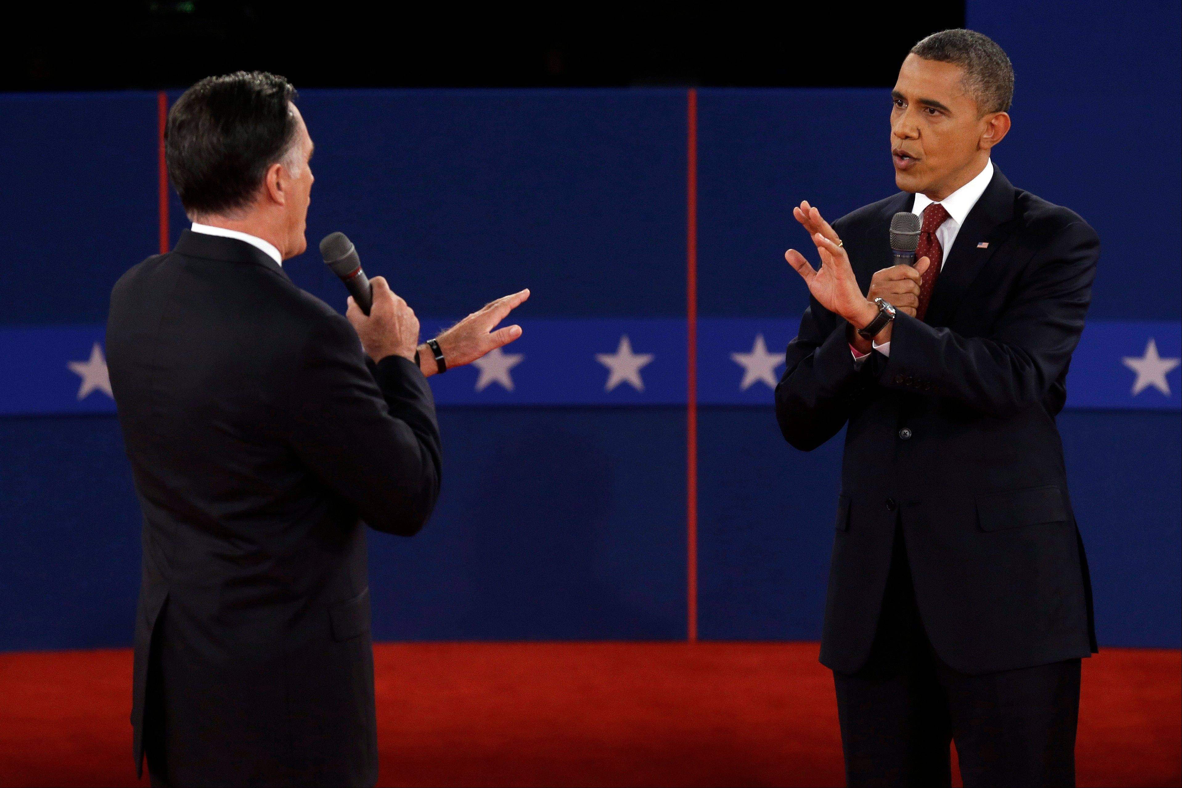 Republican presidential nominee Mitt Romney and President Barack Obama spar over energy policy during the second presidential debate at Hofstra University Tuesday night.