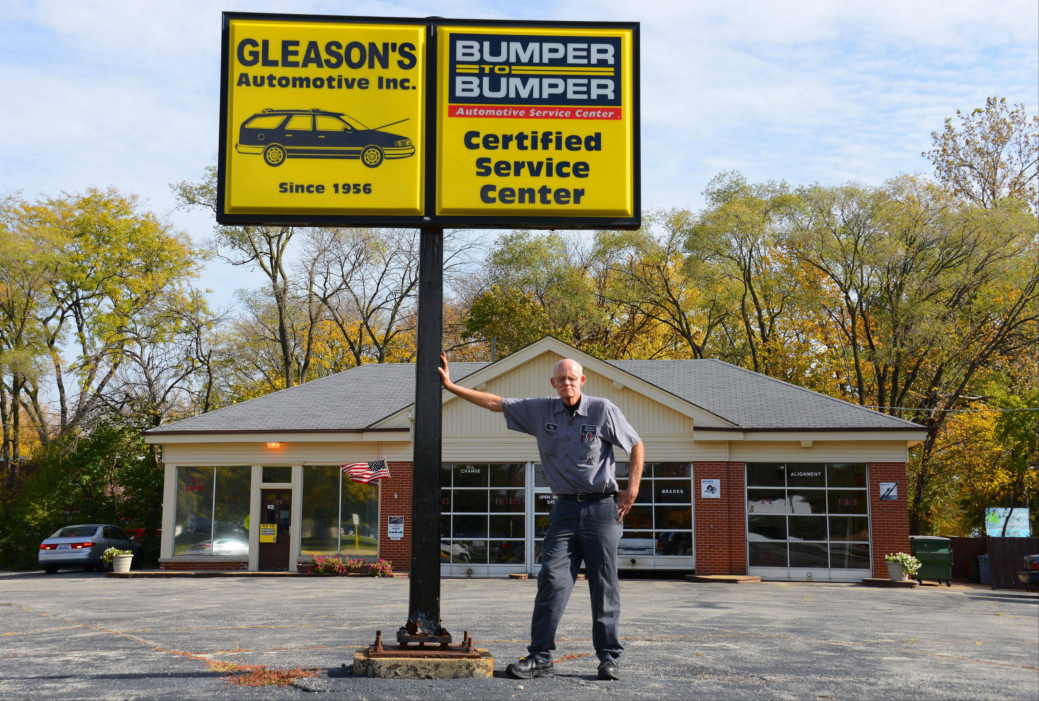 Ray Gleason stands outside his automotive shop in Des Plaines.