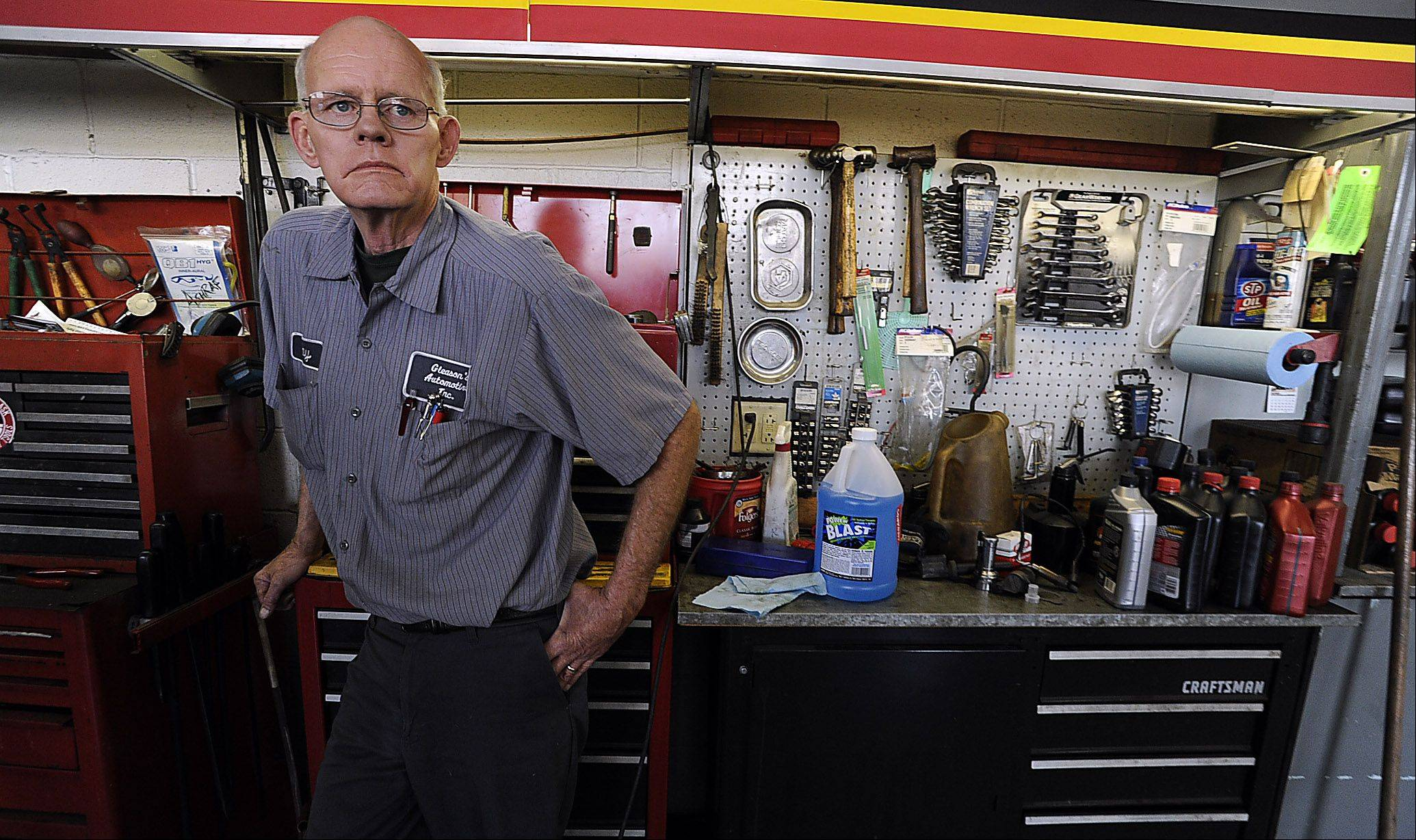 Ray Gleason stands inside his automotive shop in Des Plaines which he will be closing the door on this chapter of his life due to the economic hardship of keeping the family business alive.
