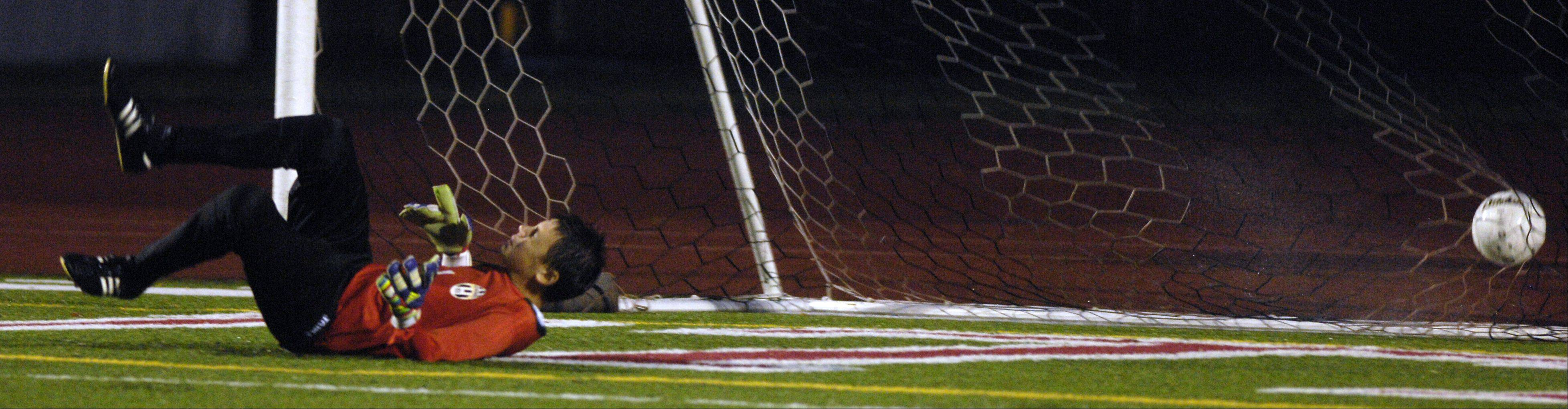 Goalkeeper Duncan Turnbull of Geneva allows a goal during his team's 7-0 loss to Naperville Central, in the boys soccer regional semifinals in Naperville, Wednesday.