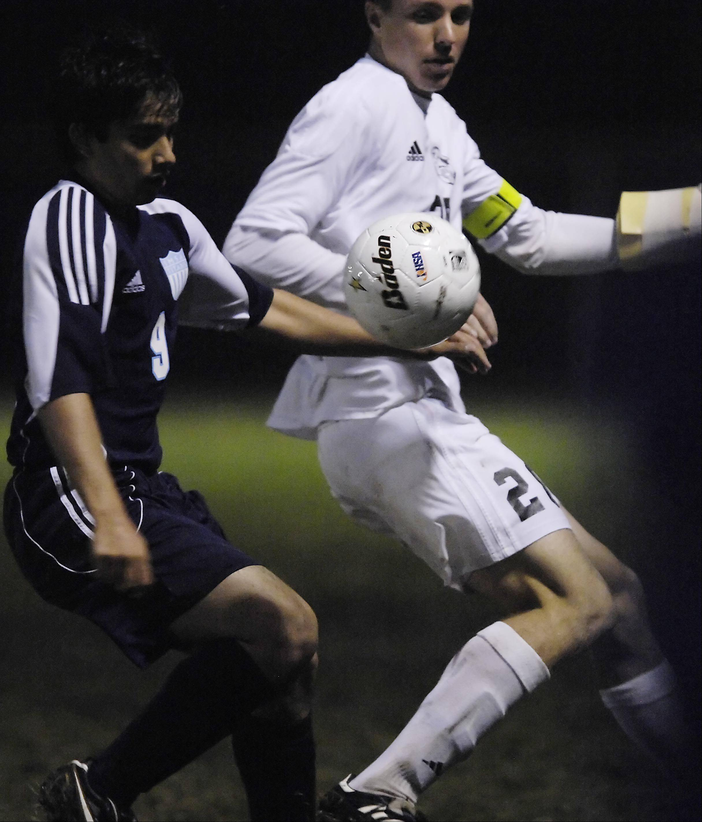 Kaneland's Alec Koczka, right, and IMSA's Ashwin Mitra battle Wednesday in the Burlington regional playoff game.