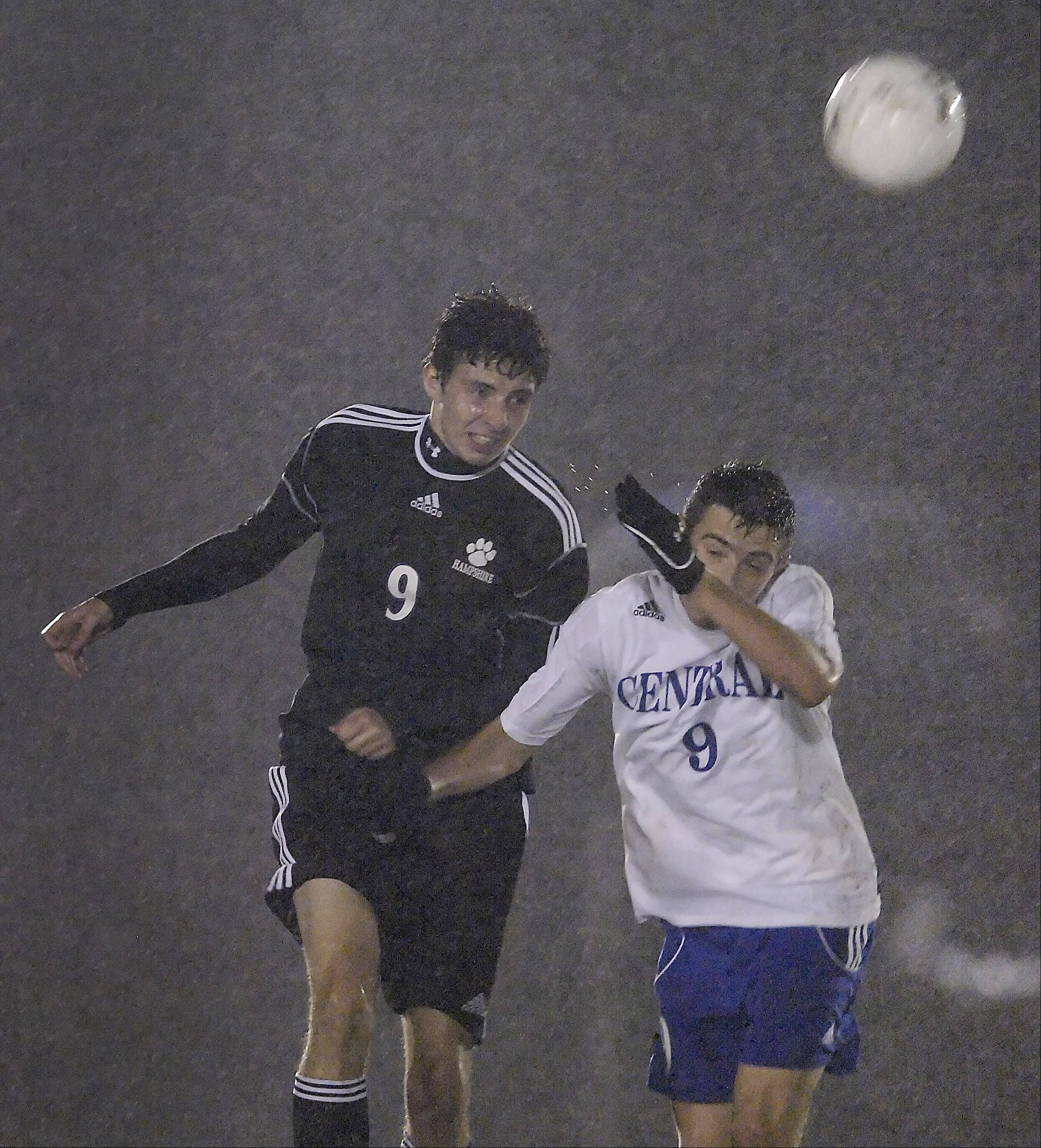 Burlington's Matt O'Connor, right, and Hampshire's Joseph Vietinghoff charge for the ball in the rain Wednesday in the Burlington regional playoff game.