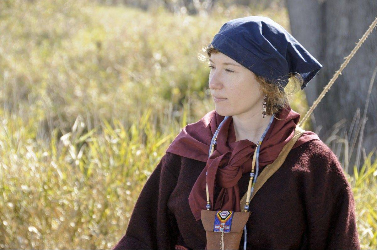 Volunteer Stacy Szymanski of Lake in the Hills portrays a woman from 1763 at the McHenry County Conservation District's Trail of History.